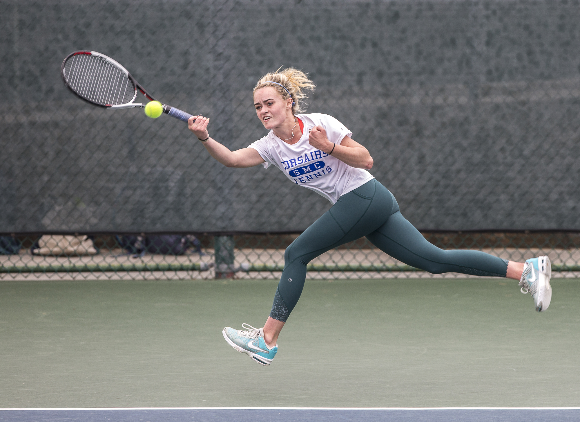 Santa Monica College Corsair sophomore Abby Mullins (#1, doubles) with great reach nails a powerful forehand strike during her doubles match against her Glendale City College Vaquero opponents consisting of sophomore Srna Lepchevska (cq) and sophomore Hailey McNall (cq) at the Ocean View Park Tennis Courts in Santa Monica, California on Tuesday, March 20 2018. The single set that Mullins and per partner played had a final score of a 2 – 8 loss, which contributed to the 0-6 match loss for the team (Matthew Martin/Corsair Photo).