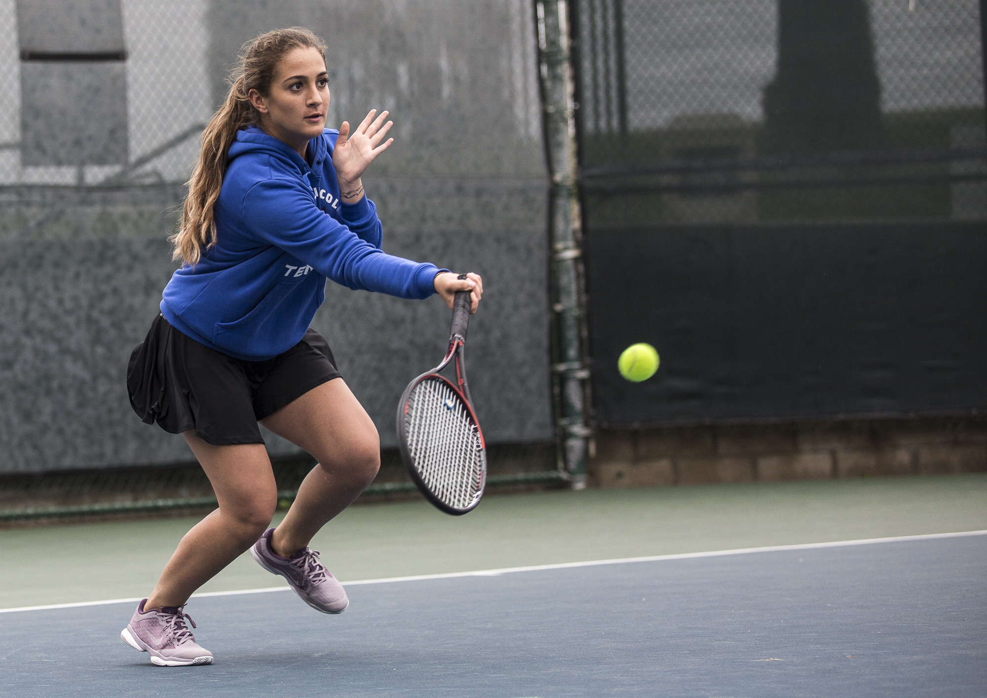 Santa Monica College Corsair freshman Mina Girit (#1, doubles) lunges forward for a powerful, short forehand swing back at her Glendale City College Vaquero opponents, consisting of sophomore Srna Lepchevska (cq) and sophomore Hailey McNall (cq), during her doubles game at the Ocean View Park Tennis Courts in Santa Monica, California on Tuesday, March 20 2018. The single set that Girit and her partner Abby Mullins played consisted of a 2 – 8 set loss, which contributed to the 0-6 match loss for the team. (Matthew Martin/Corsair Photo).