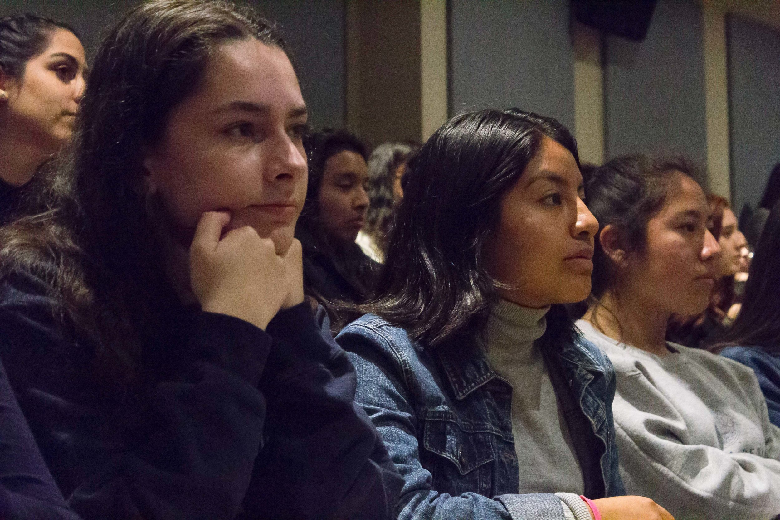 Chelsea Moran, 17 (left) and Melisa Ramirez Hernandez, 15 (middle), are students from Santa Monica High School. They came with 13 other students as a field trip through their Spanish program to see Jenny Lorenzo. The Award Winning YouTube star, talked to the students about promoting Latinx Voices in Social Media, at Santa Monica College, in Santa Monica, California, on Tuesday, March 20, 2018.  The room HSS165 and its 120 seats were full, about 15 students had to wait in the hallway, by the door. (Emeline Moquillon/ Corsair Photo)