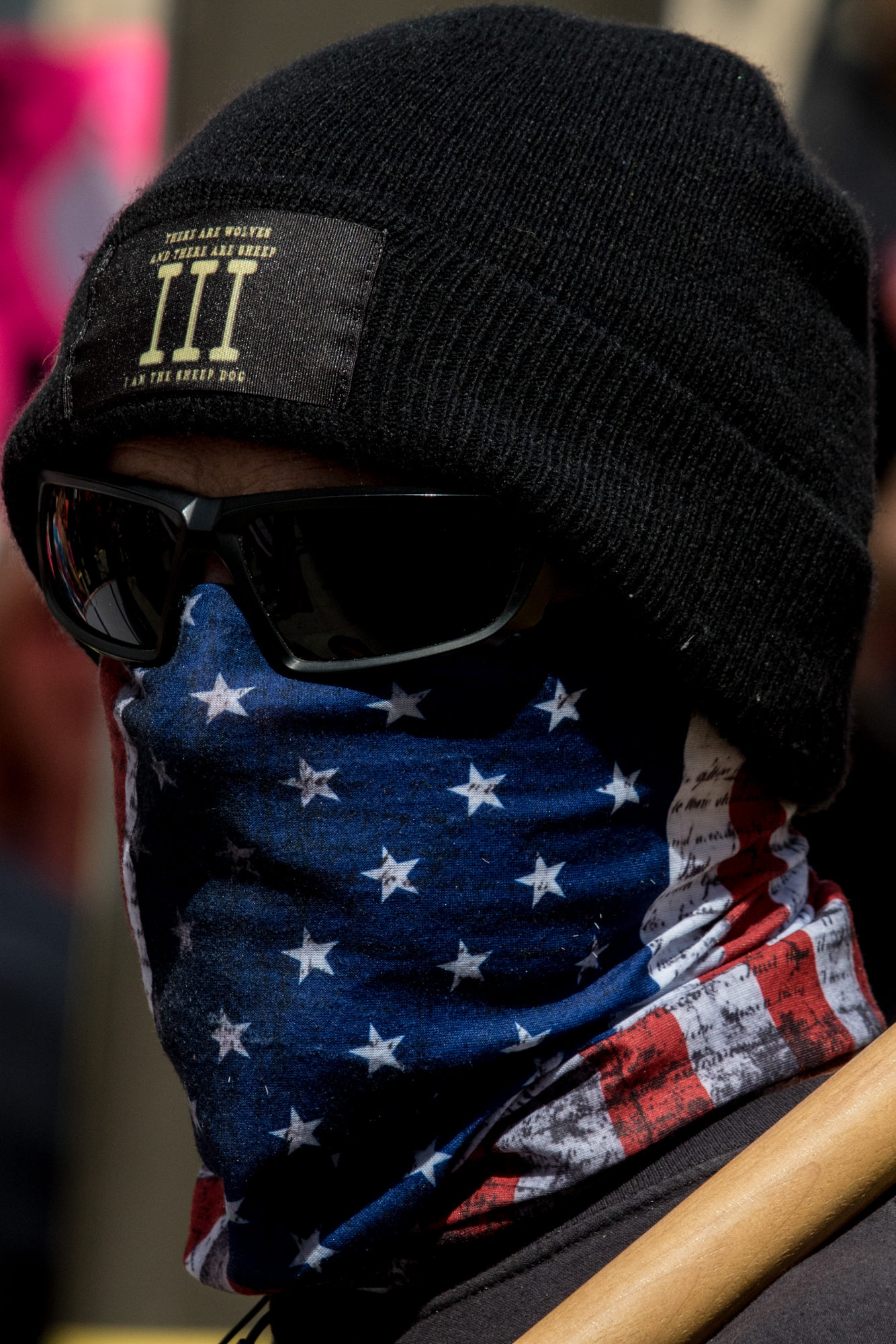 A masked Donald Trump supporter at the March For Our Lives protest on March 24, 2018 in Los Angeles, California. (Zane Meyer-Thornton/Corsair Photo)