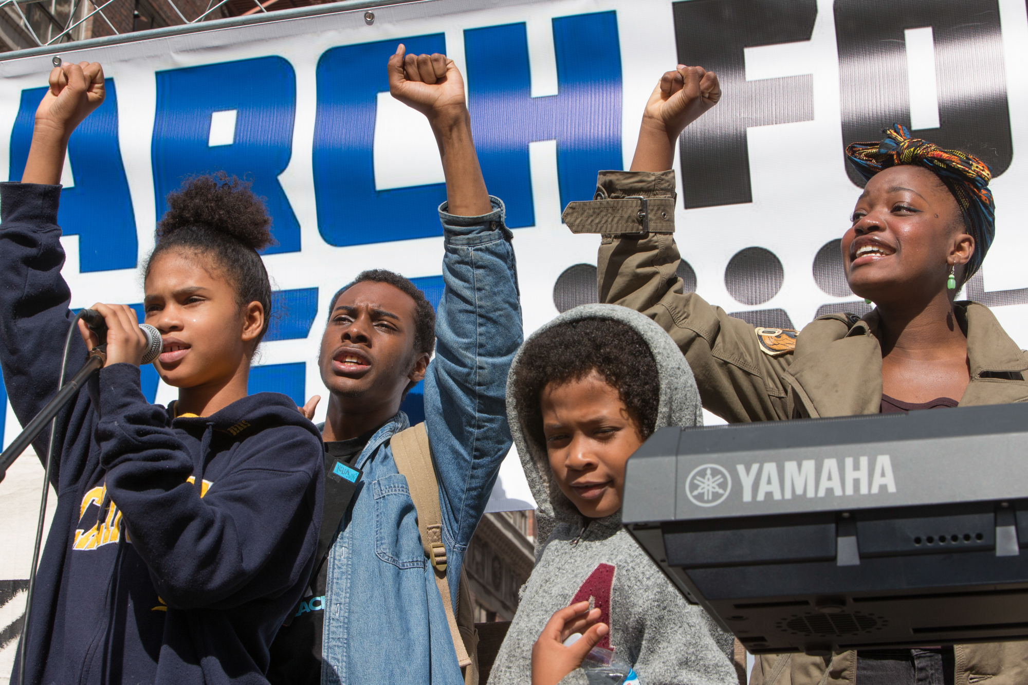 A group of young student activists, stand at the podium on 5th and Broadway in downtown Los Angeles, before marching to City Hall during the March for Our Lives rally on March 24, 2018, in Los Angeles, California. (Daniel Bowyer/Corsair Photo)