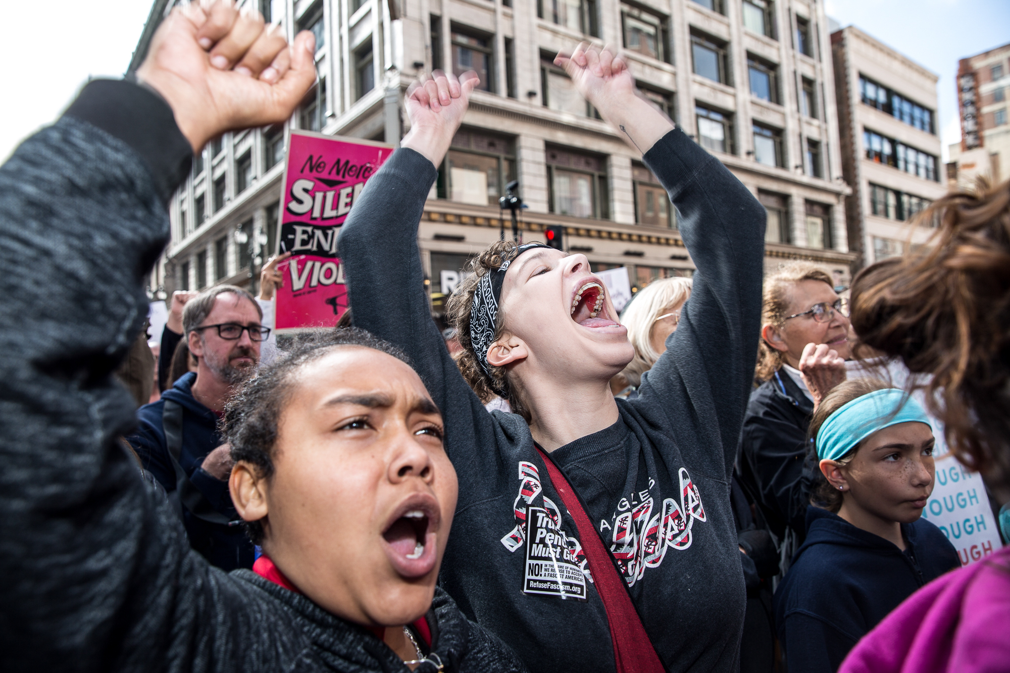 Alex Garcia (left) and Avery Dehart (right) cheer and shout with enthusiasm as they listen to guest speakers give their opinion on the lack of gun regulation in the U.S before protestors began their march toward city hall in downtown Los Angeles, California on Saturday, March 24 2018. The rally began near Pershing Square at 9 a.m. and the march moved to Grand Park, where there were speakers and performers. Speakers included students and survivors of previous mass shootings like Columbine, Las Vegas and the Seal Beach salon shooting.(Matthew Martin/Corsair Photo)