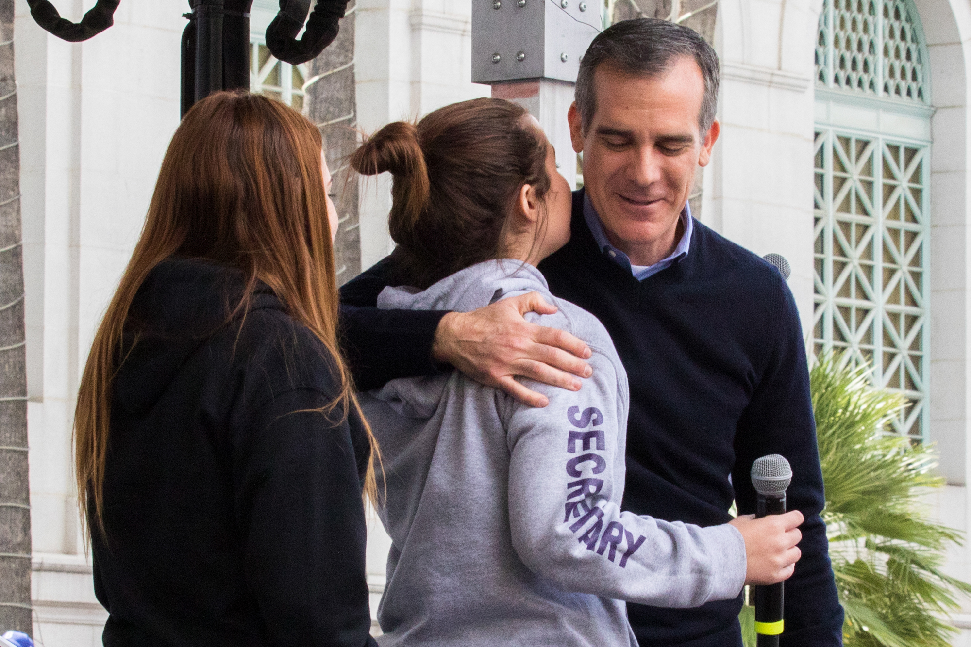 Los Angeles Mayor Eric Garcetti embraces 2 of the student speakers at the March For Our Lives protest on March 24, 2018 in Los Angeles, California. (Zane Meyer-Thornton/Corsair Photo)