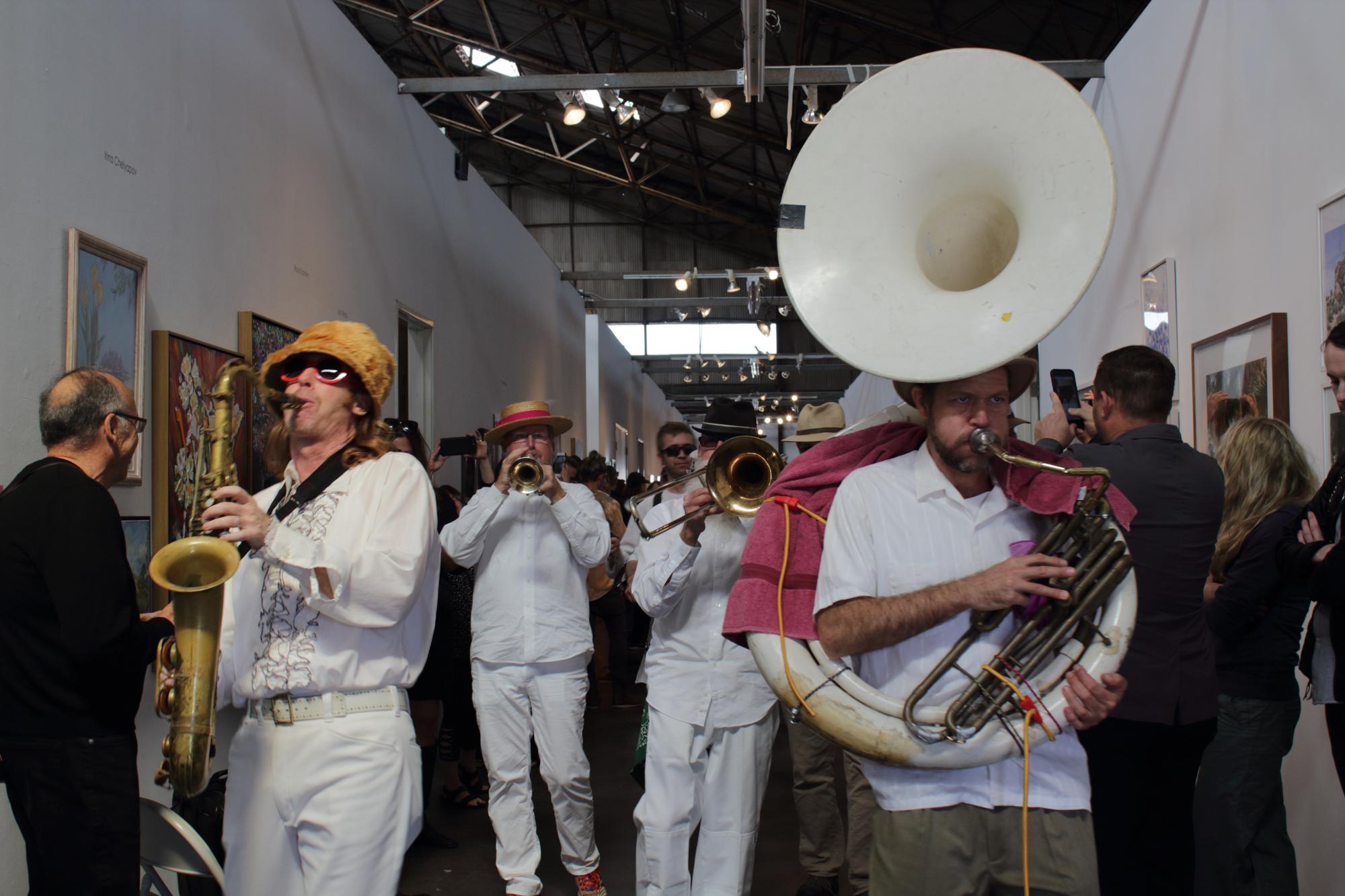 Carmen Peréz Memorial Marching Band playing down the hall of the Santa Monica Art Studios while spectators watch at the 12 Annual Santa Monica ArtWalk on March 24th, 2018 in Santa Monica, California. (Heather Creamer/ Corsair Photo).