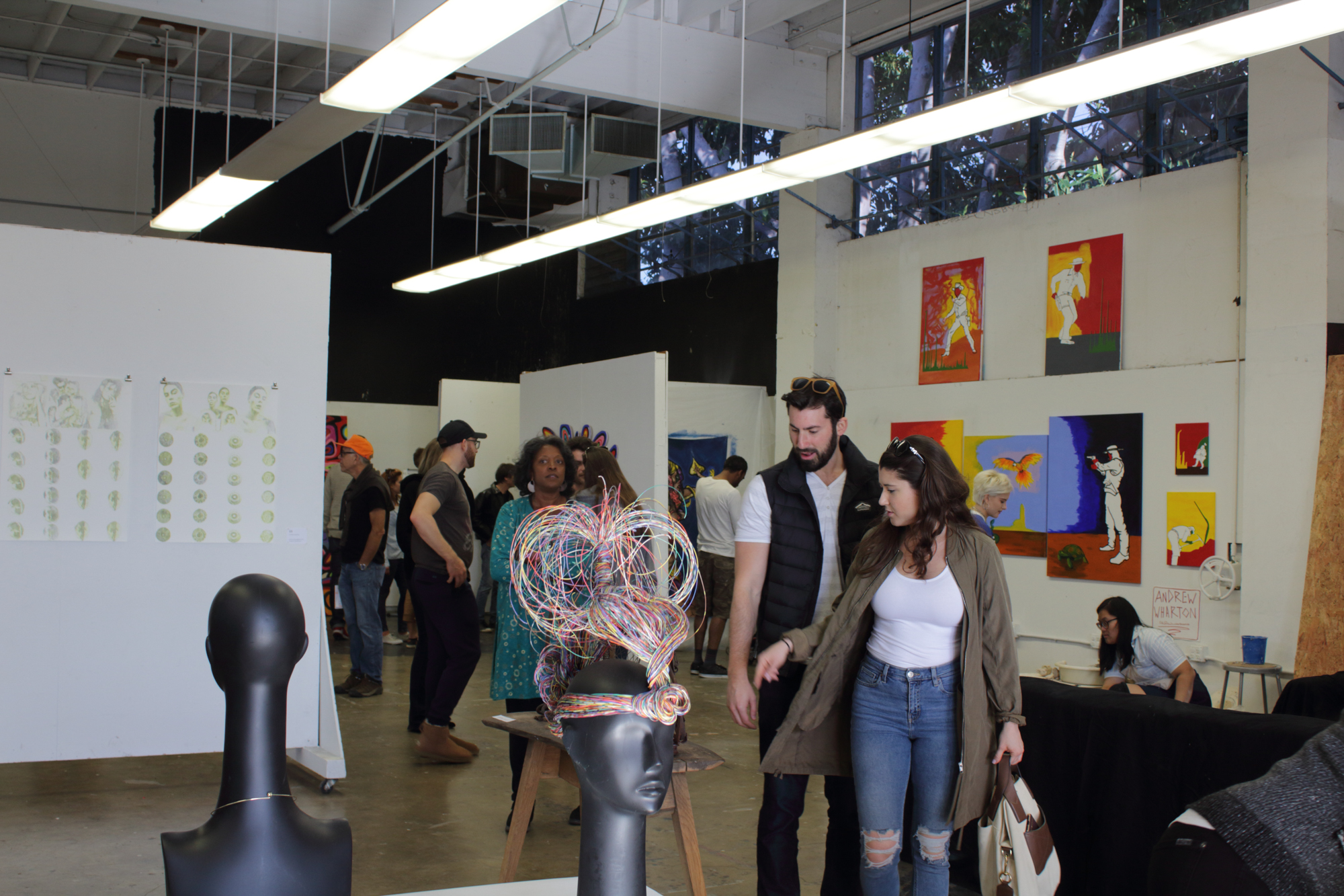 Spectators walk through the SMC Art Mentor Program gallery, mentored by Christopher Badger, at the 12 Annual Santa Monica ArtWalk on March 24th, 2018 in Santa Monica, California. (Heather Creamer/ Corsair Photo)..