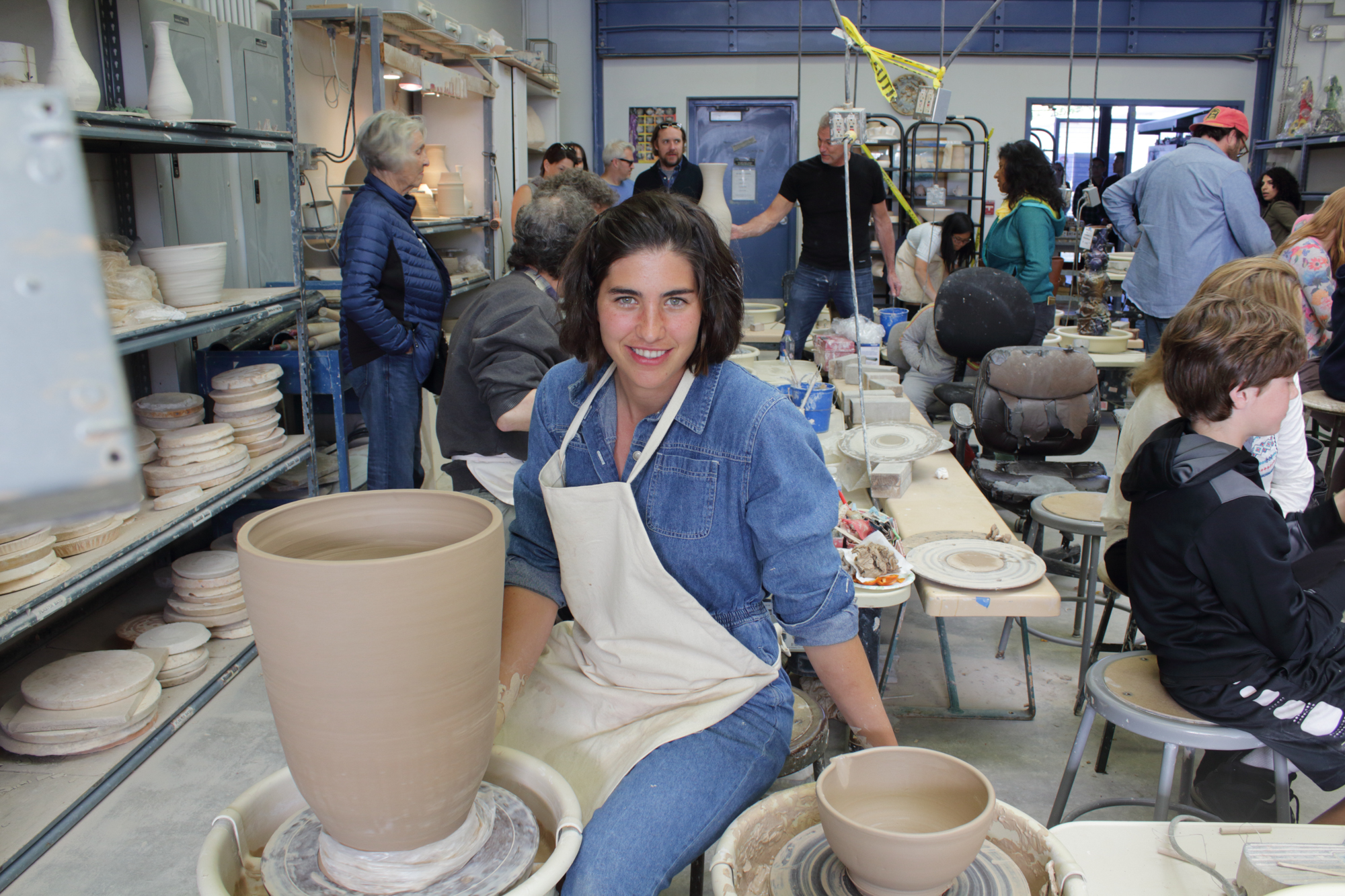 Nerea Nicholson, an Early Childhood Development major at SMC with a love for ceramics, poses while working on two pieces in the SMC Ceramic Arts Gallery at the 12 Annual Santa Monica ArtWalk on March 24th, 2018 in Santa Monica, California. (Heather Creamer/ Corsair Photo).