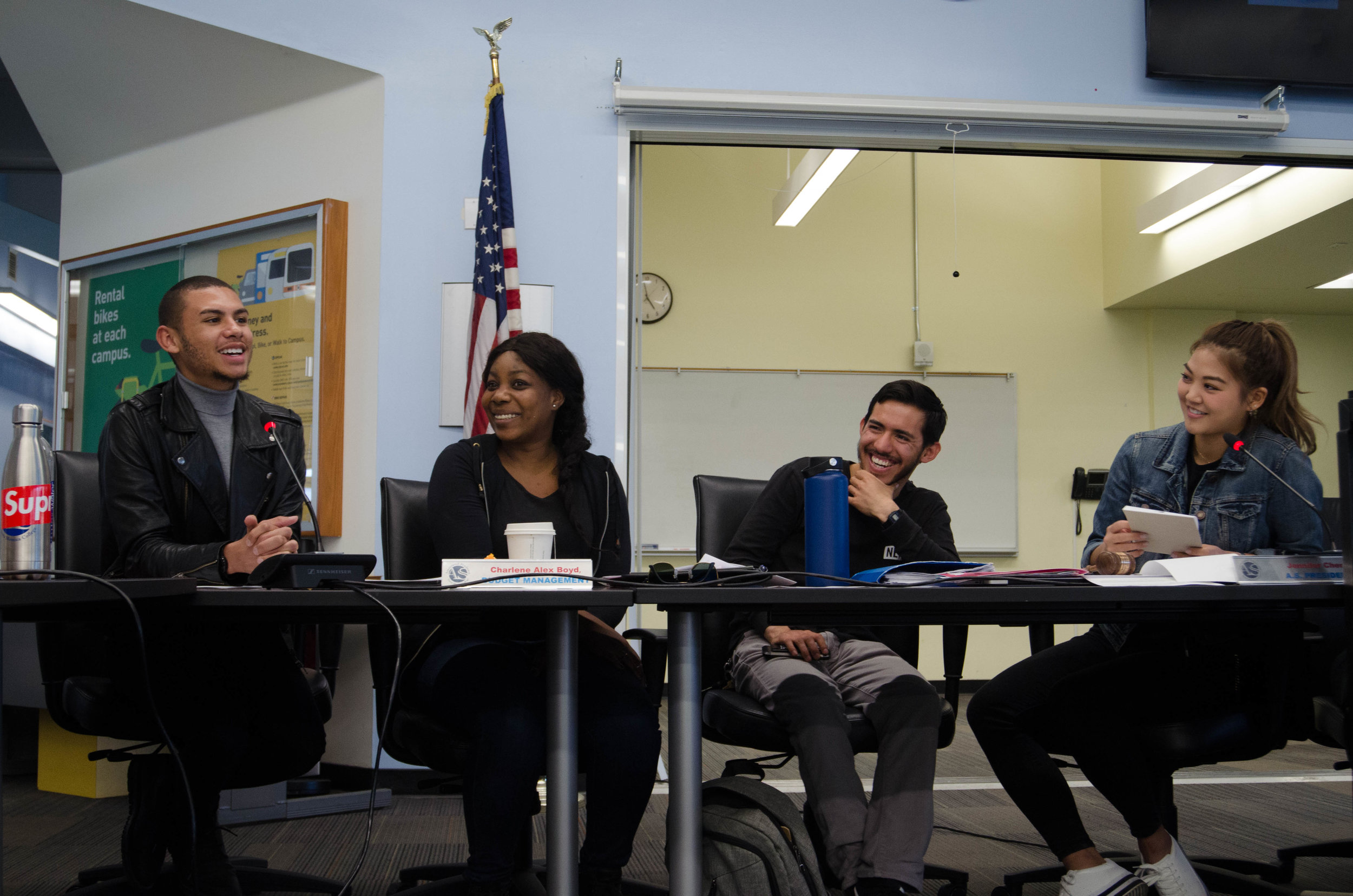 Associated Students President Jennifer Chen (far right) and Student Trustee Chase Matthews (far left) roleplay an interaction between a Congressman and an advocate, to the amusement of Director of Budget Management Charlene Alex Boyd (center left) and Vice President George Sandoval (center right) In the Associated Students' Center at Santa Monica College in Santa Monica, California. (Reed Curtis/Corsair Photo)Monica College in Santa Monica, California, Associated Students. (L-R) President Jennifer Chen, Faculty Advisor Dr. Nancy Grass, Director of Student Assistance Ana Laura Paiva, Director of Publicity Stephanie Hernandez, Director of Activities Saori Gurung, Director of Student Advovacy Santiago Guerrero, Director of Budget Managment Charlene Alex Boyd, A.S. Vice President Geoge Sandoval, Student Trustee Chase Matthews, and Director of Student Outreach Max Gong. (Reed Curtis/Corsair Photo)