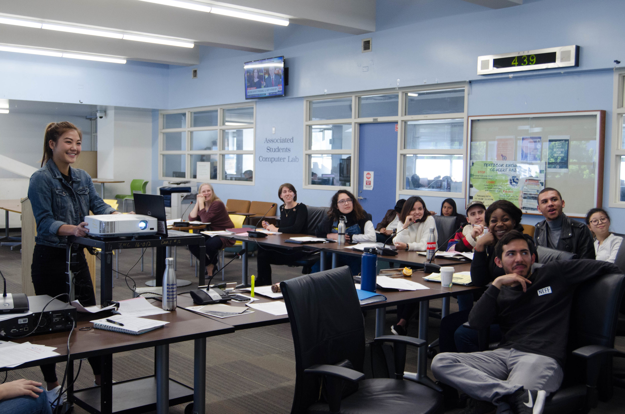 """A.S. President Jennifer Chen presents a """"behind the scenes"""" video of the Associated Students delegation's recent trip to the National Student Advocacy Conference to her fellow board members In the Associated Students' Center at Santa"""