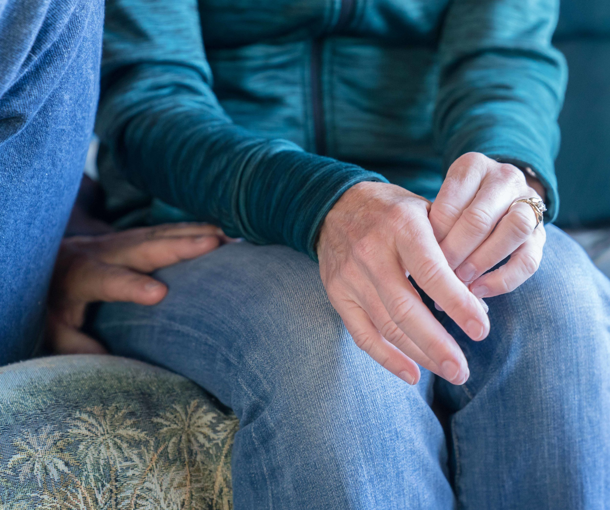 A detail of Kathy Welch's hands as she talks to a reporter in her home in Hermosa Beach, California on Saturday, March 17, 2018 about the death of her son, David Sliff. Welch's husband, Tom Welch, who was Sliff's stepfather, places his hand on his wife's leg. (Helena Sung/Corsair Photo)
