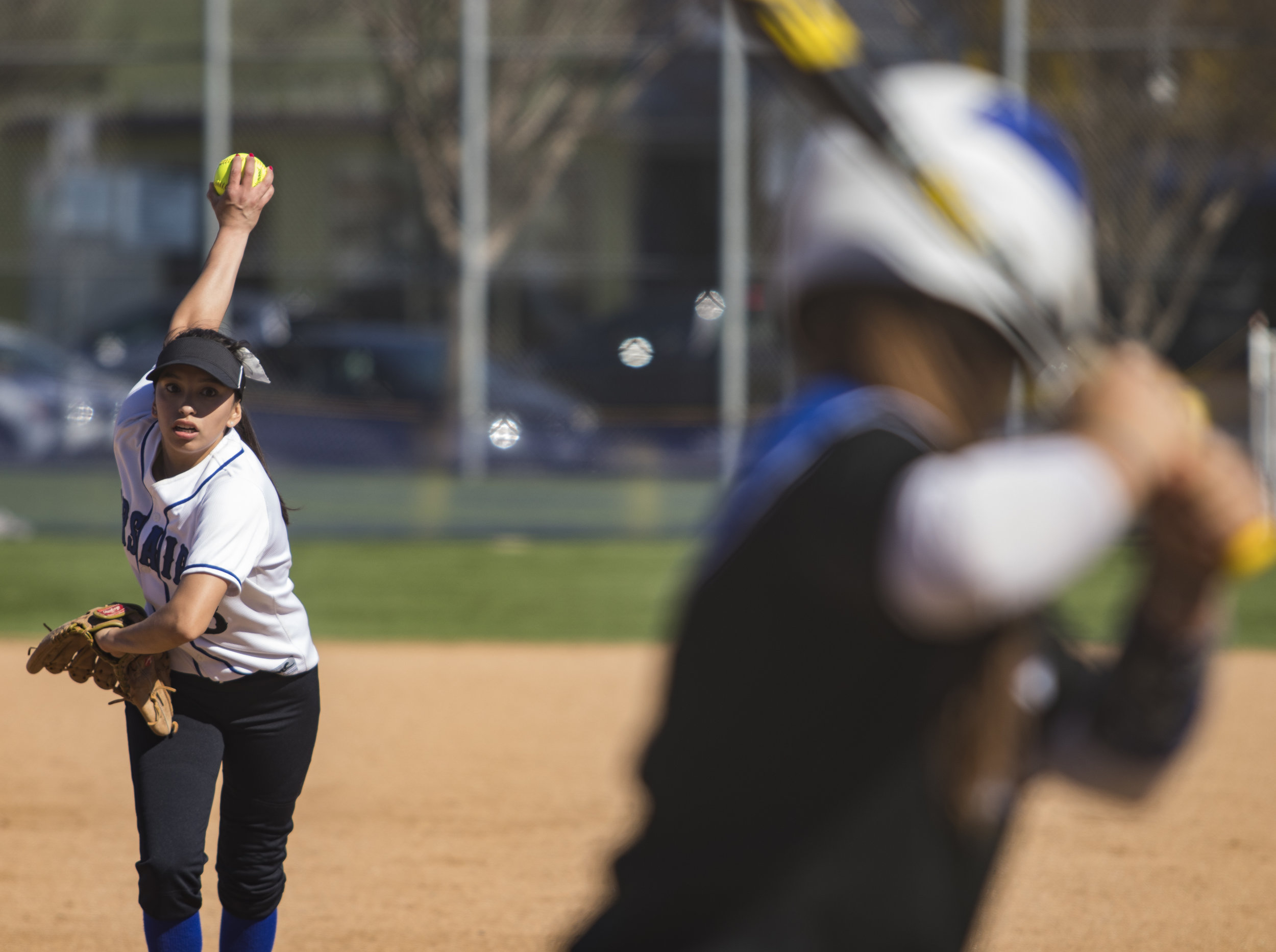 Ashley Nava pitching for The Santa Monca Corsair during Tuesday, March 27, 2018, game against the Allan Hancock Bulldogs at John Adams Middle School in Santa Monica, California. The Corsair fell 8-1 to the Bulldogs and are now 1-4 in their conference. (Brian Quiroz // Staff Writer)