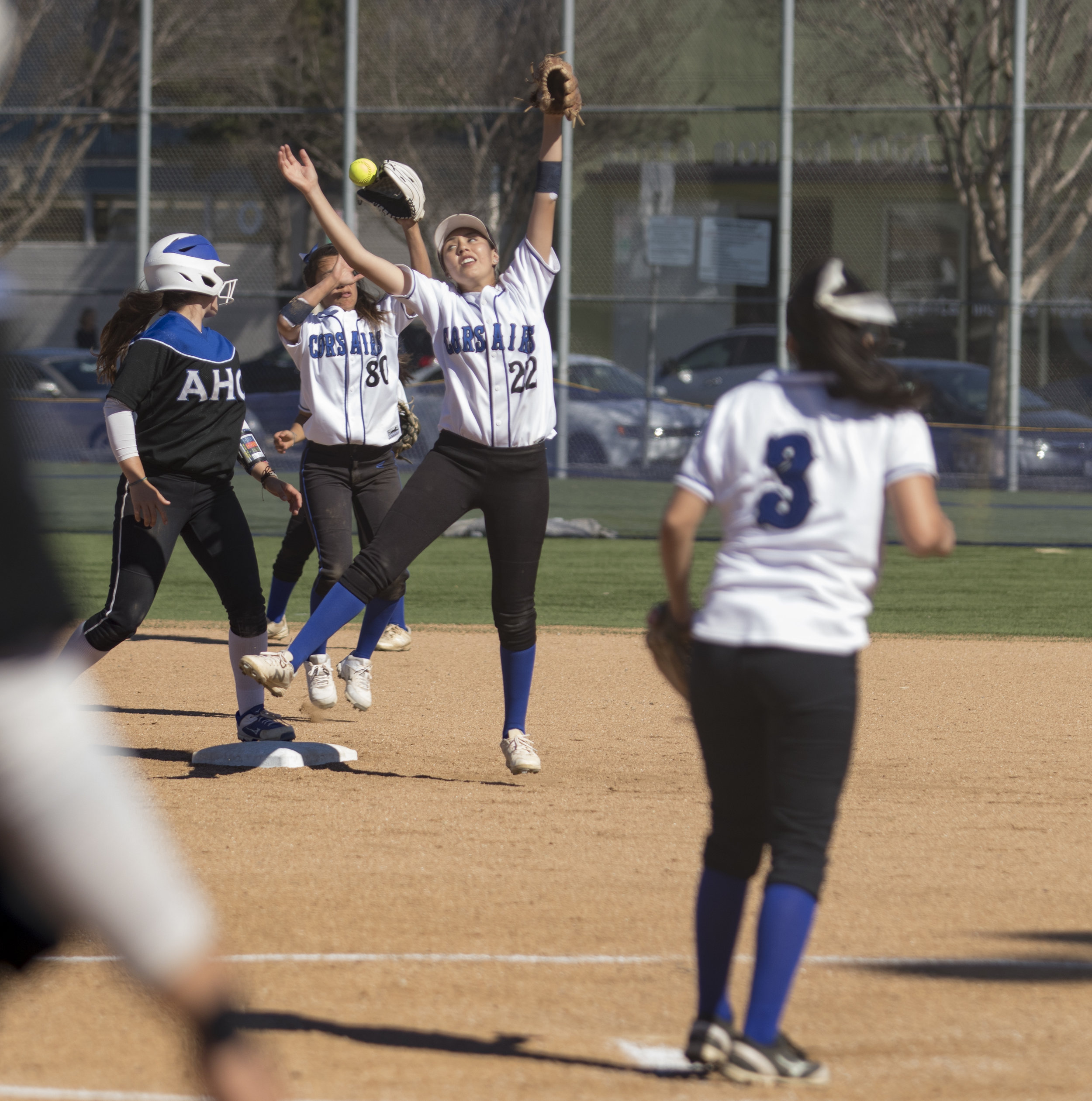 Santa Monica Corsair players jumping for the ball during Tuesday, March 27, 2018, game against the Allan Hancock Bulldogs at John Adams Middle School in Santa Monica, California. The Corsair fell 8-1 to the Bulldogs and are now 1-4 in their conference. (Brian Quiroz // Staff Writer)