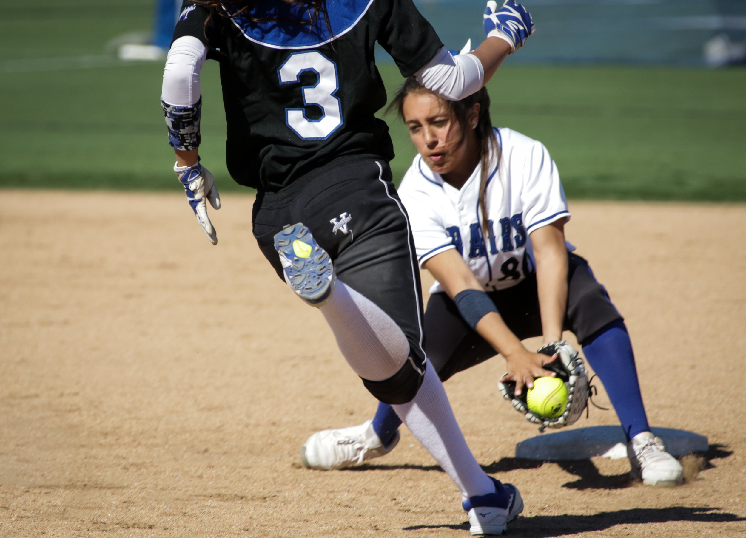 Santa Monica College Corsair softball team player Emma Soto (Right) in the process of successfully forcing out her opponent during their game against Allan Hancock College on Tuesday, March 27th, 2018. The game ended 8-1 in favor for Allan Hancock College. (Santa Monica, California, Tuesday March  27, 2018.) (Corsair/Ashutosh  Bikram Singh)