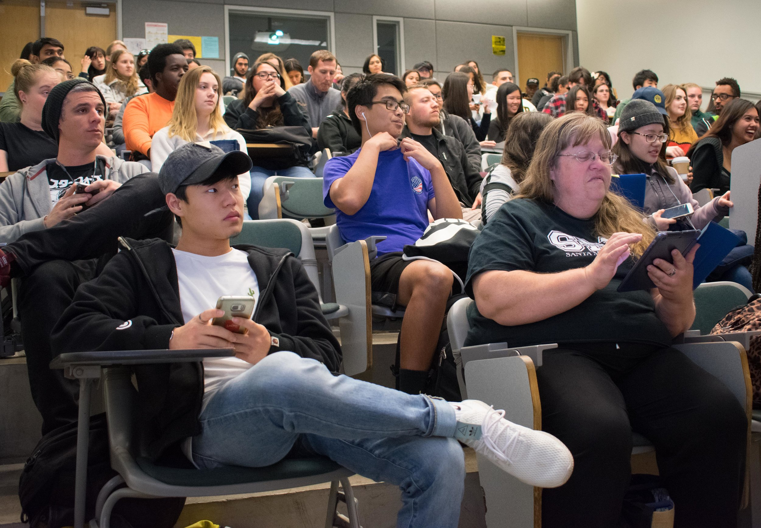 Sheng Min Sun, left, the Vice President of Service and members of Phi Theta Kappa, an honor society at Santa Monica College meet in the Science building, room 140 at 11:15 a.m. for the weekly meeting on Tuesday, March 20 in Santa Monica, California. Students wishing to join must pay an $80 membership fee, which is a one-time fee during their time at the college, but students have to maintain a 3.0 GPA. Benefits that PTK advertise are scholarships, volunteer opportunities, and a transcript notation. (Ethan Lauren/Corsair Photo)