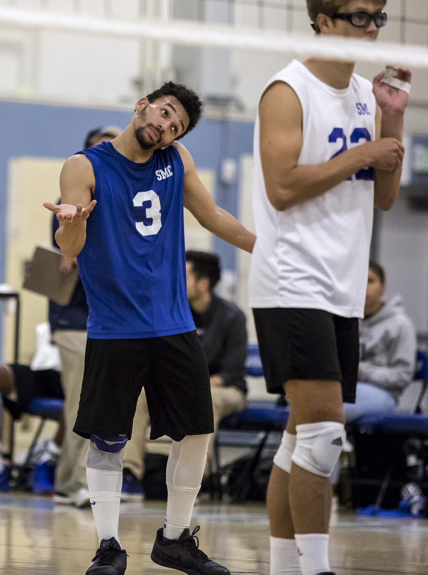 Santa Monica College Corsair Libero Elijah Chambers #3 (center/left, blue) shrugs to one of his teammates after losing a point to The Los Angeles Trade Tech College Beavers during the Corsairs 3-0 blowout victory against the Tech Beavers in the Santa Monica College (SMC) Pavilion at the SMC main campus in Santa Monica California, on Friday, March 30 2018. (Matthew Martin/Corsair Photo).