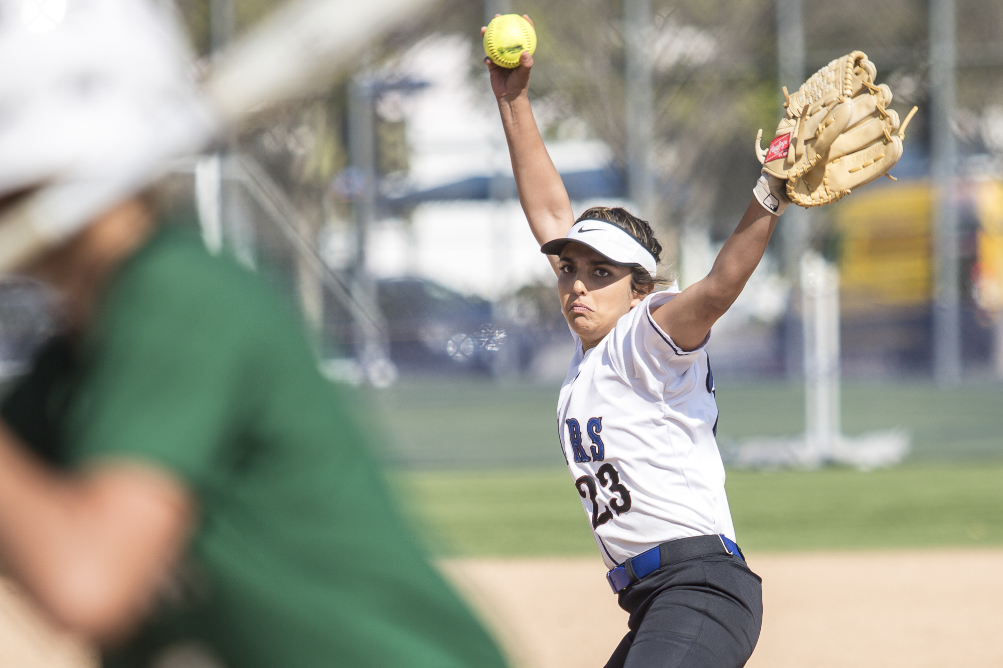 Santa Monica College freshman pitcher Taylor Liebesman winds up to pitch the ball at the Cuesta College Cougar batter at the John Adams Middle School field in Santa Monica California, on Tuesday, April 3 2018. The Santa Monica Corsairs lost 6-5 against the Cuesta College Cougars in the ten-inning softball game. (Matthew Martin/Corsair Photo)