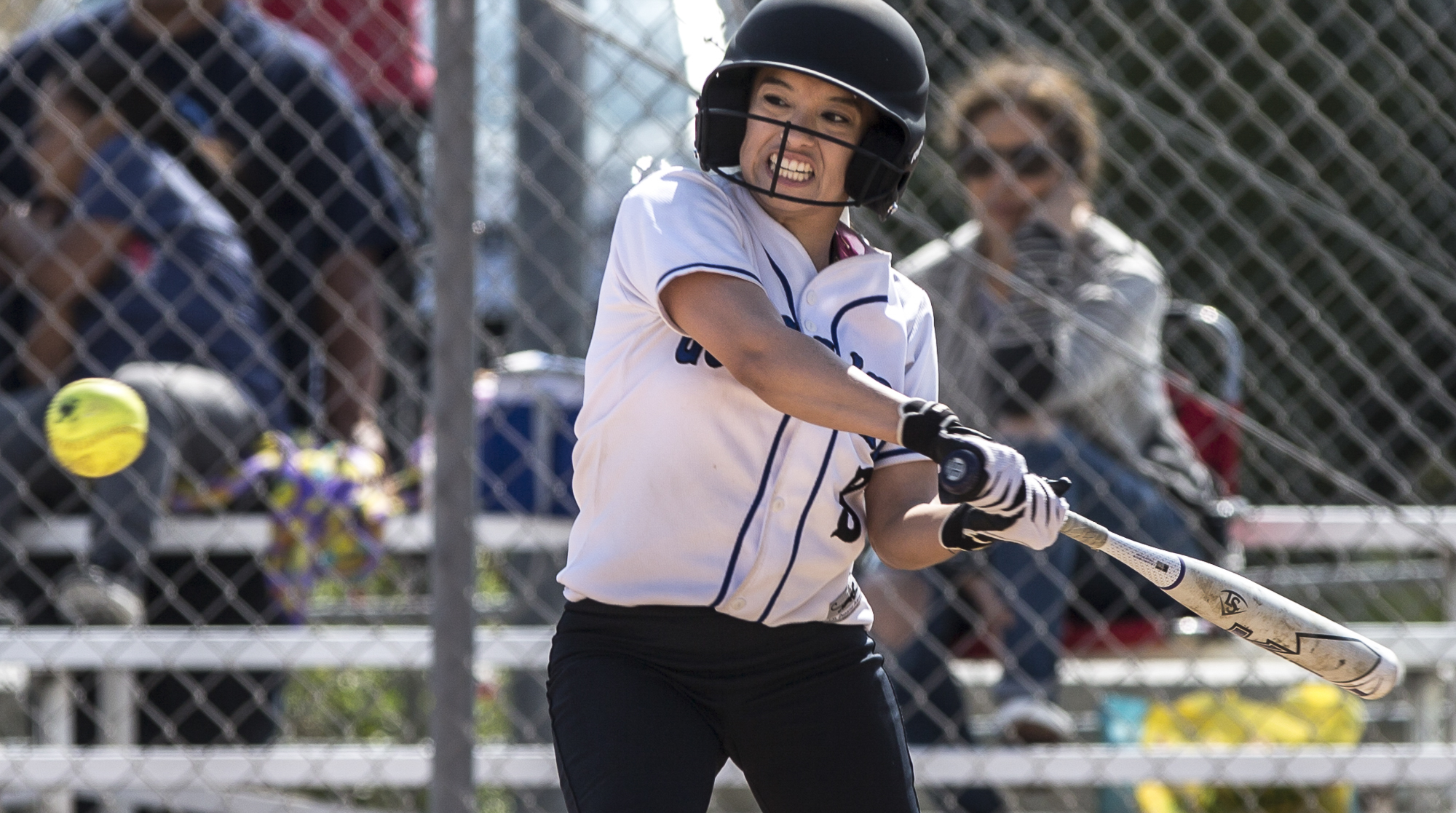 Santa Monica College Corsair freshman batter Ashley Nava prepares to nail a powerful curveball thrown by Cuesta College Cougar pitcher sophomore Taylor Rasmusson at the John Adams Middle School field in Santa Monica California, on Tuesday, April 3 2018. The Santa Monica Corsairs lost 6-5 against the Cuesta College Cougars in the ten-inning softball game. (Matthew Martin/Corsair Photo)