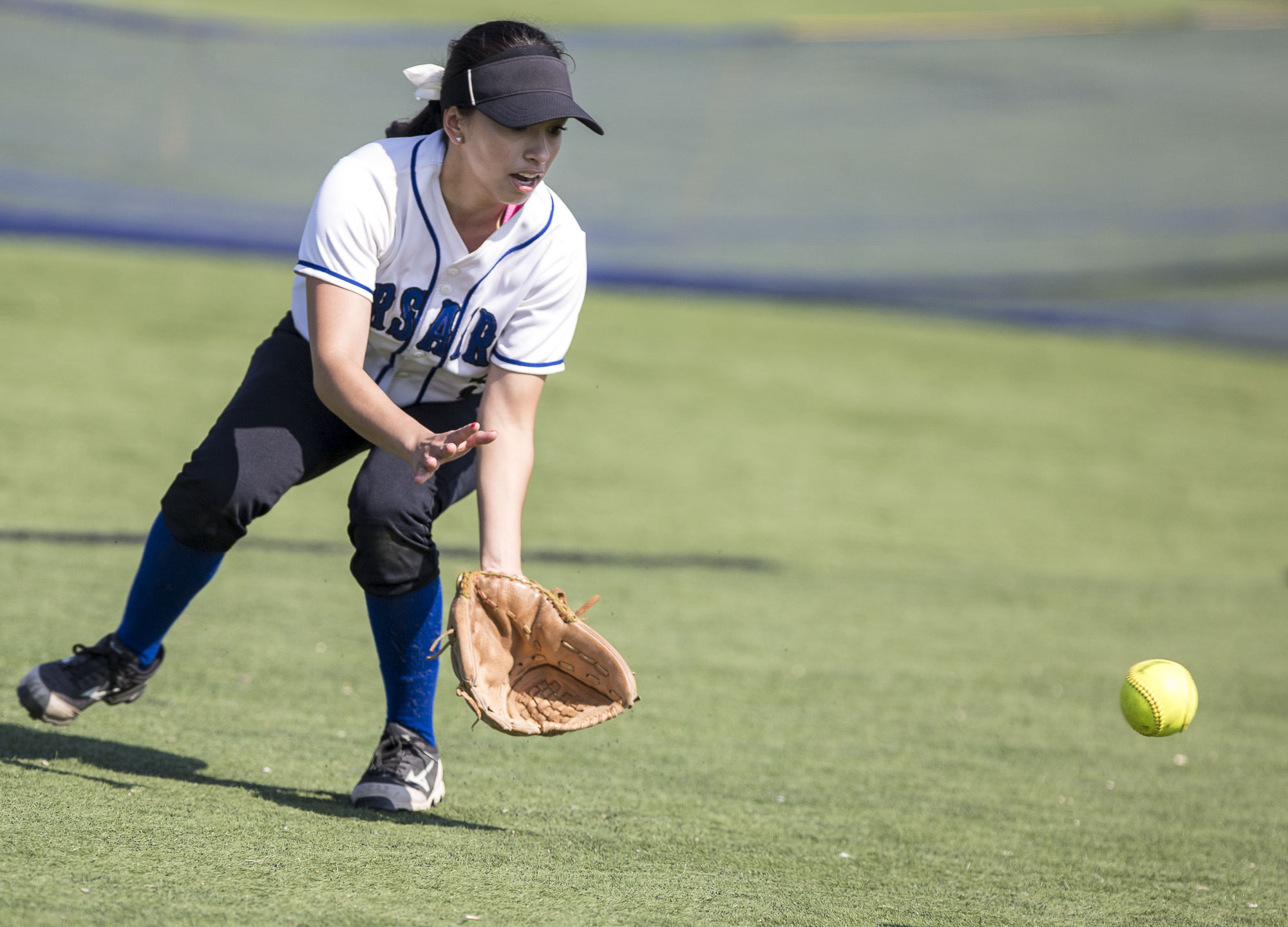 Santa Monica College Corsair freshman out-fielder Ashley Nava prepares to field the ball and throw it towards 2nd base at the bottom of the 3rd at the John Adams Middle School field in Santa Monica California, on Tuesday, April 3 2018. The Santa Monica Corsairs lost 6-5 against the Cuesta College Cougars in the ten-inning softball game. (Matthew Martin/Corsair Photo)