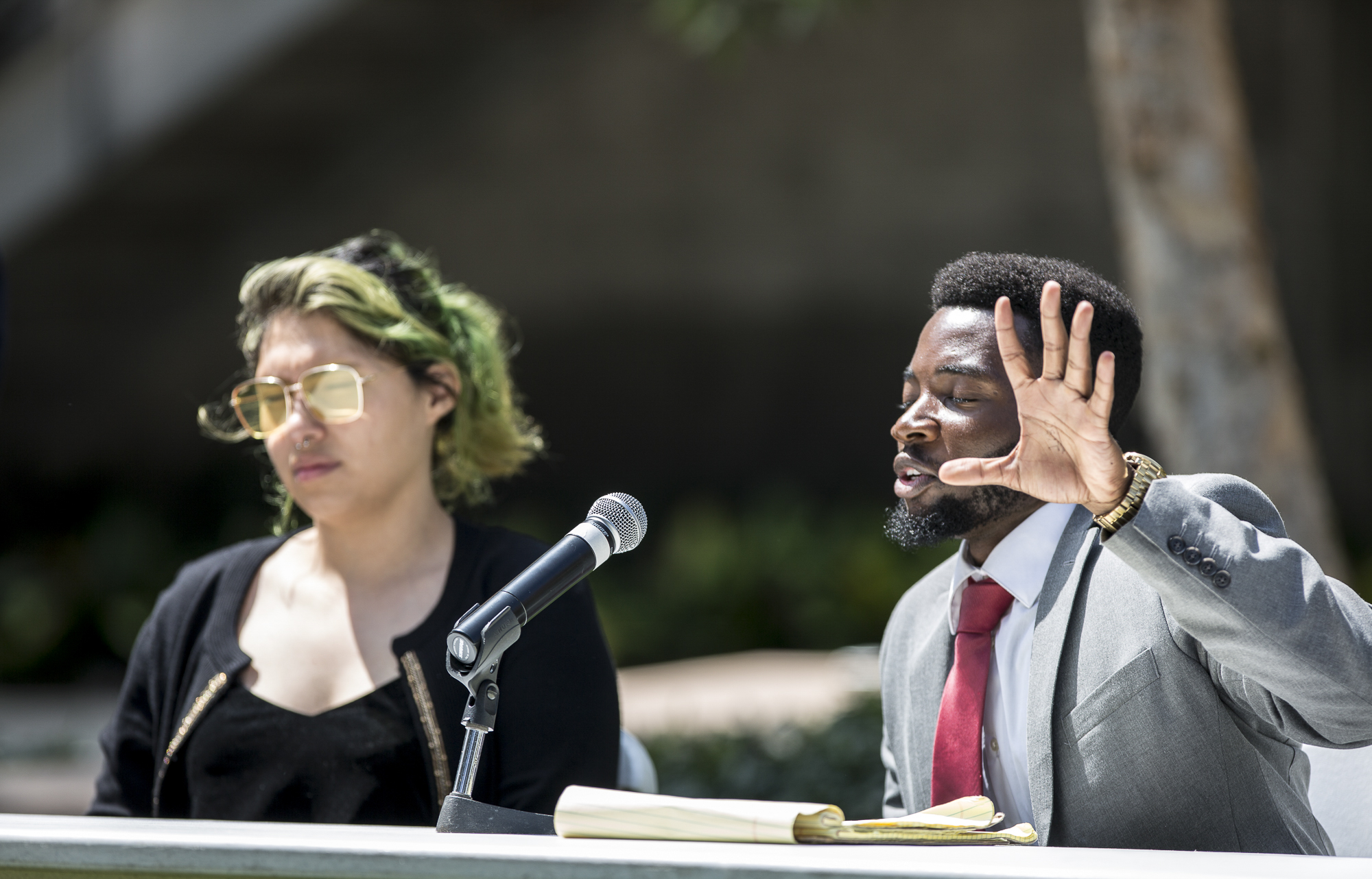 Santa Monica College Associate Student (A.S) Director of Student Advocacy candidates Alexa Benavente (left) and Gosple Ofoegbu (right) take questions from those in attendance during the A.S election debate on the quad of the Santa Monica College main campus in Santa Monica California, on Tuesday, April 3, 2018. (Matthew Martin/Corsair Photo)
