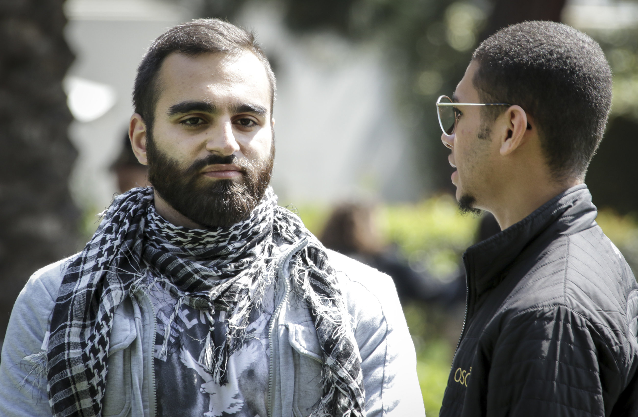 Santa Monica College Associated Students Candidate Hesham Jarmakani (Left) and Chase Matthews (Right) at the Associates Students election debate held at the quad of the main campus. Jarmakani is running for the position of the vice president. Chase Matthews is currently Student Trustee. Santa Monica, California, Tuesday April 3, 2018. (Ashutosh Bikram Singh/Corsair Photo)