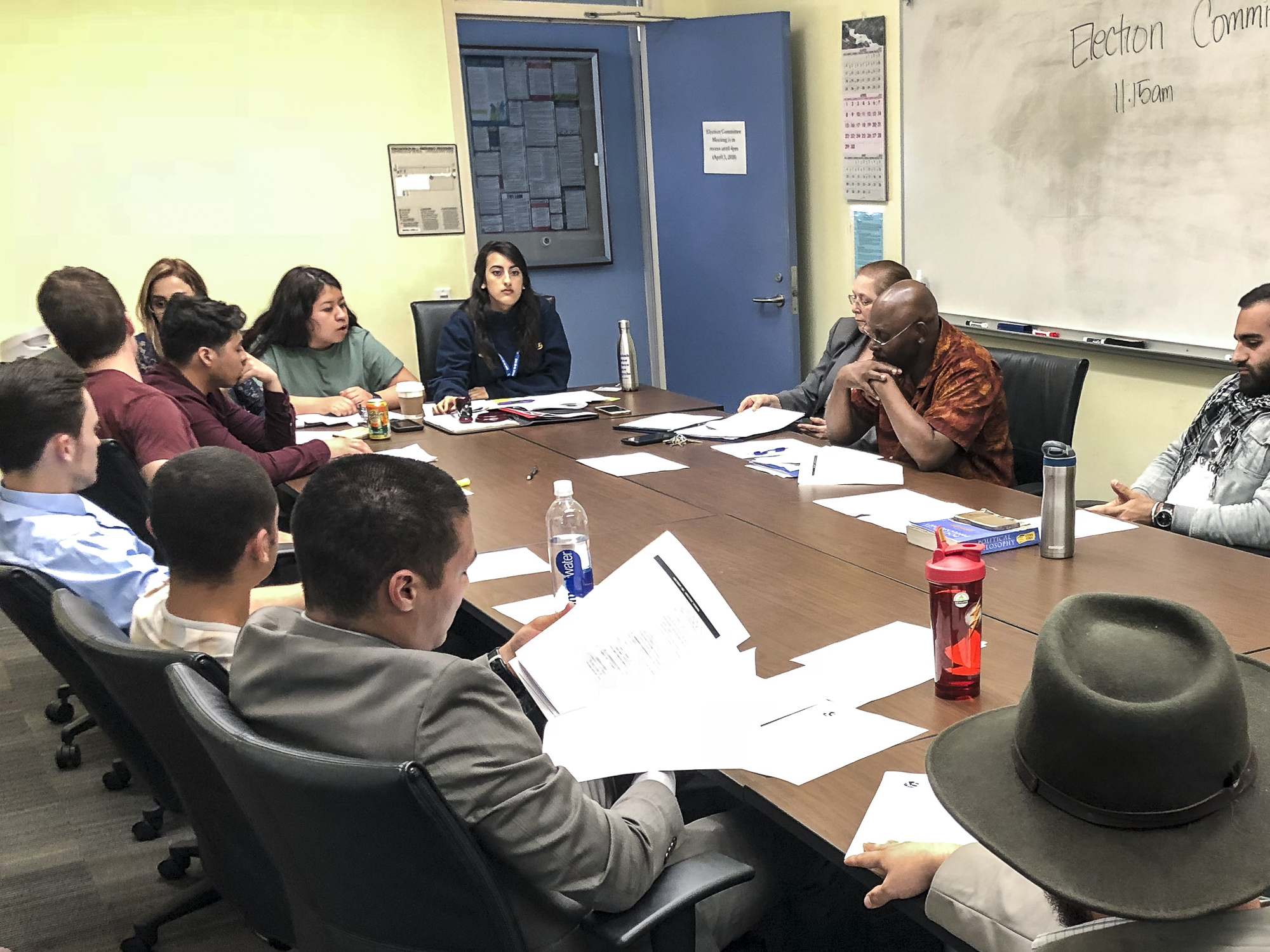The Election Committee Members discuss a variety of filed violations amongst committee members and Associated Student candidates at the election committee meeting held in the conference room in the Cayton Center on Santa Monica College's main campus in Santa Monica, California on Tuesday, April 3, 2018. (Pictured candidates, bottom left, Ben Kolodny, middle left, Beau Espeso, middle right, Hesham Jarmakani) (Ryanne Mena/Corsair Photo)
