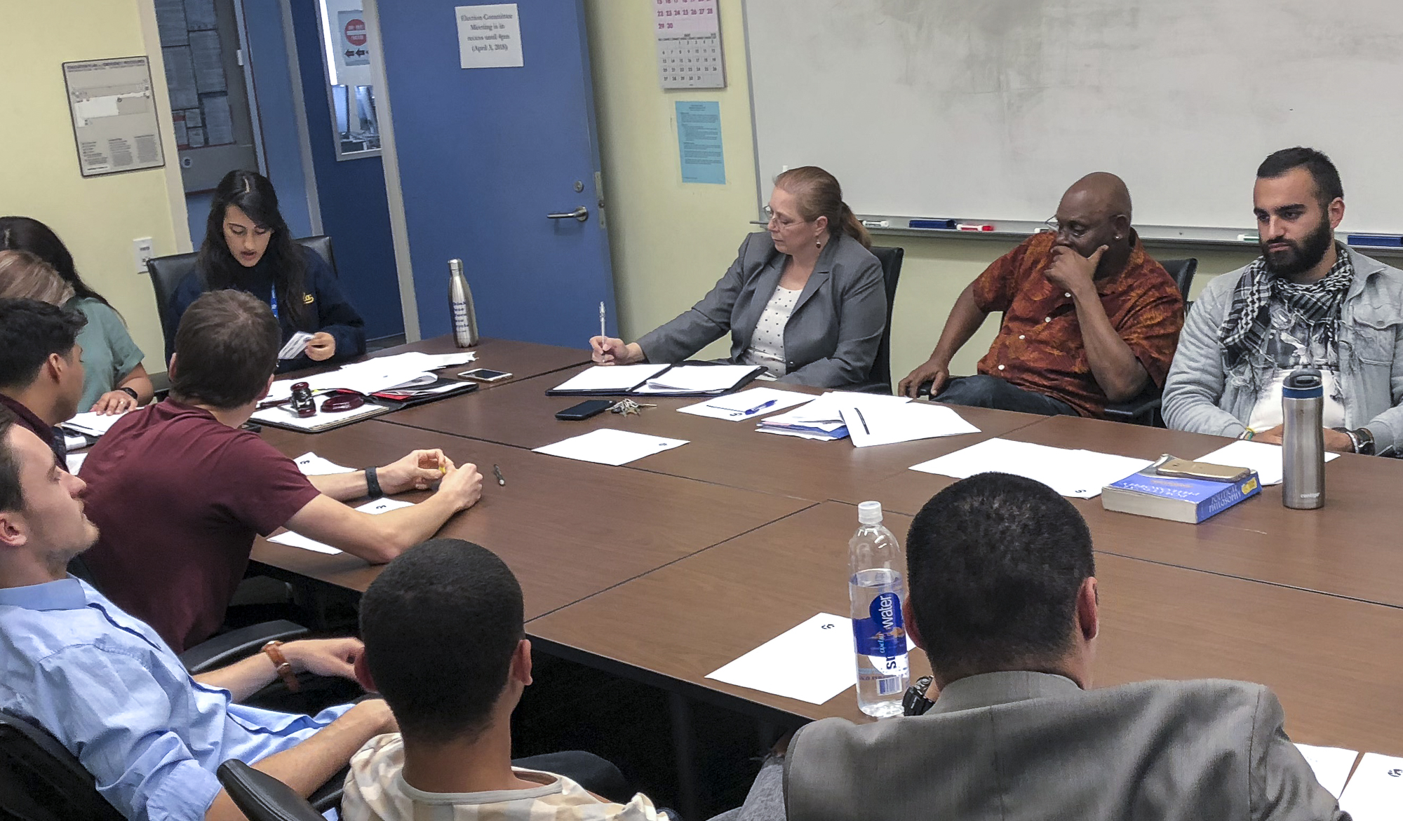 The Election Committee Members discuss a variety of filed violations amongst committee members and Associated Student candidates at the election committee meeting held in the conference room in the Cayton Center on Santa Monica College's main campus in Santa Monica, Calif.ornia on Tuesday, April 3, 2018. (Ryanne Mena/Corsair Photo)