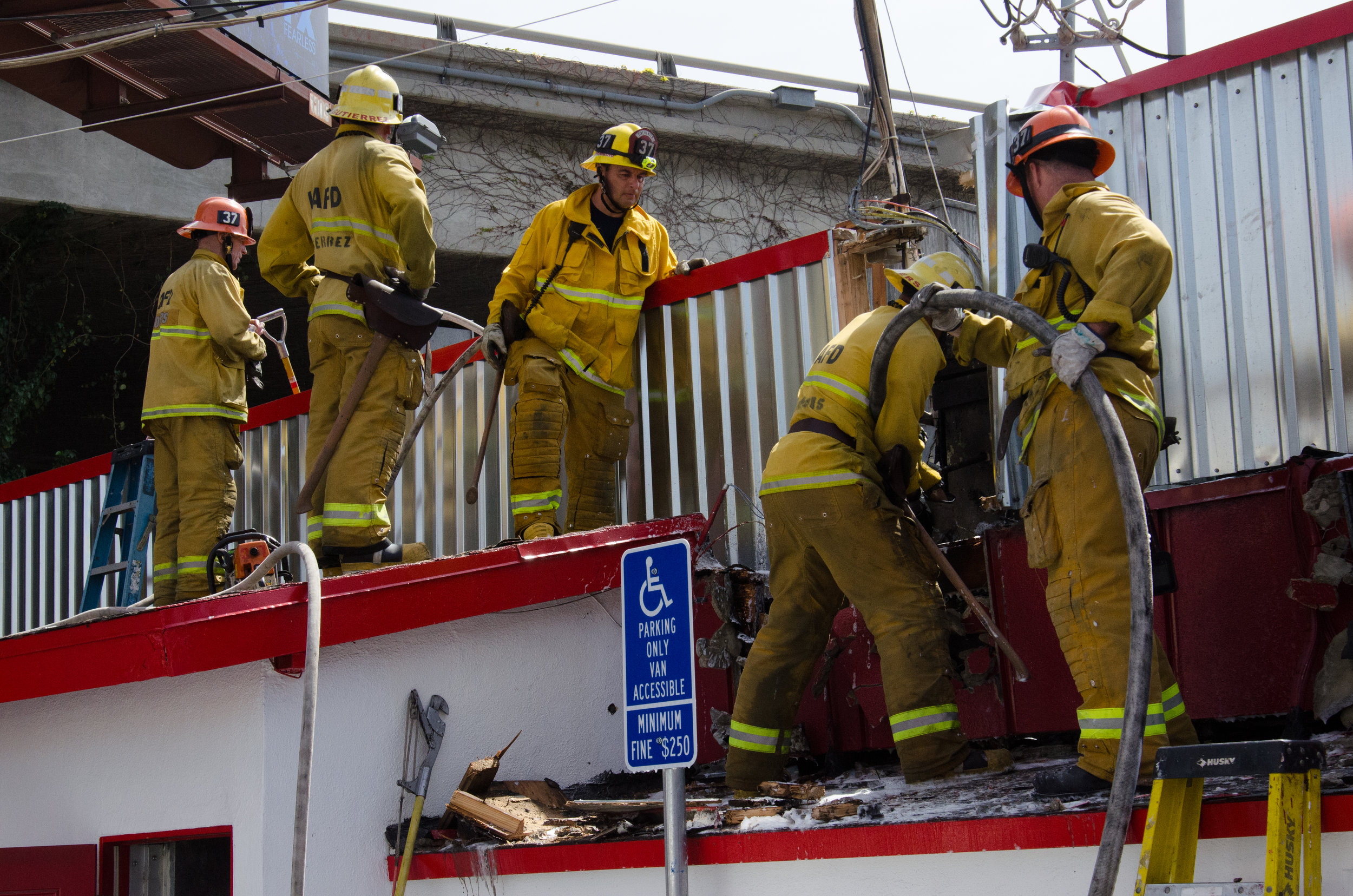 LAFD Firefighters from Station 37 extinguish the fire within the wall of Big Tomy's restaurant on Pico and Sawtelle on April 6th, 2018. (Reed Curtis/Corsair Photo)