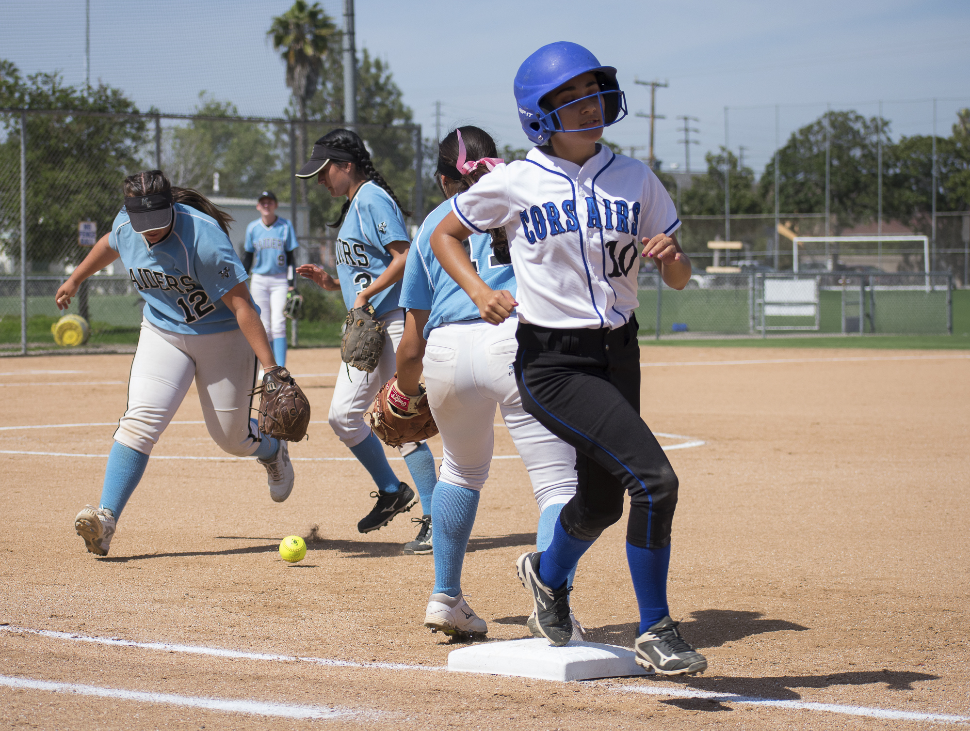 Santa Monica Corsairs Briana Osuna (#10) runs past first base during a softball game against the Moorpark College Raiders on Tuesday, April 10 at the John Adams Middle School Field in Santa Monica, California. The game ended with an 11-8 loss for the Corsairs, further continuing their six-game loss. (Ethan Lauren/Corsair Photo)