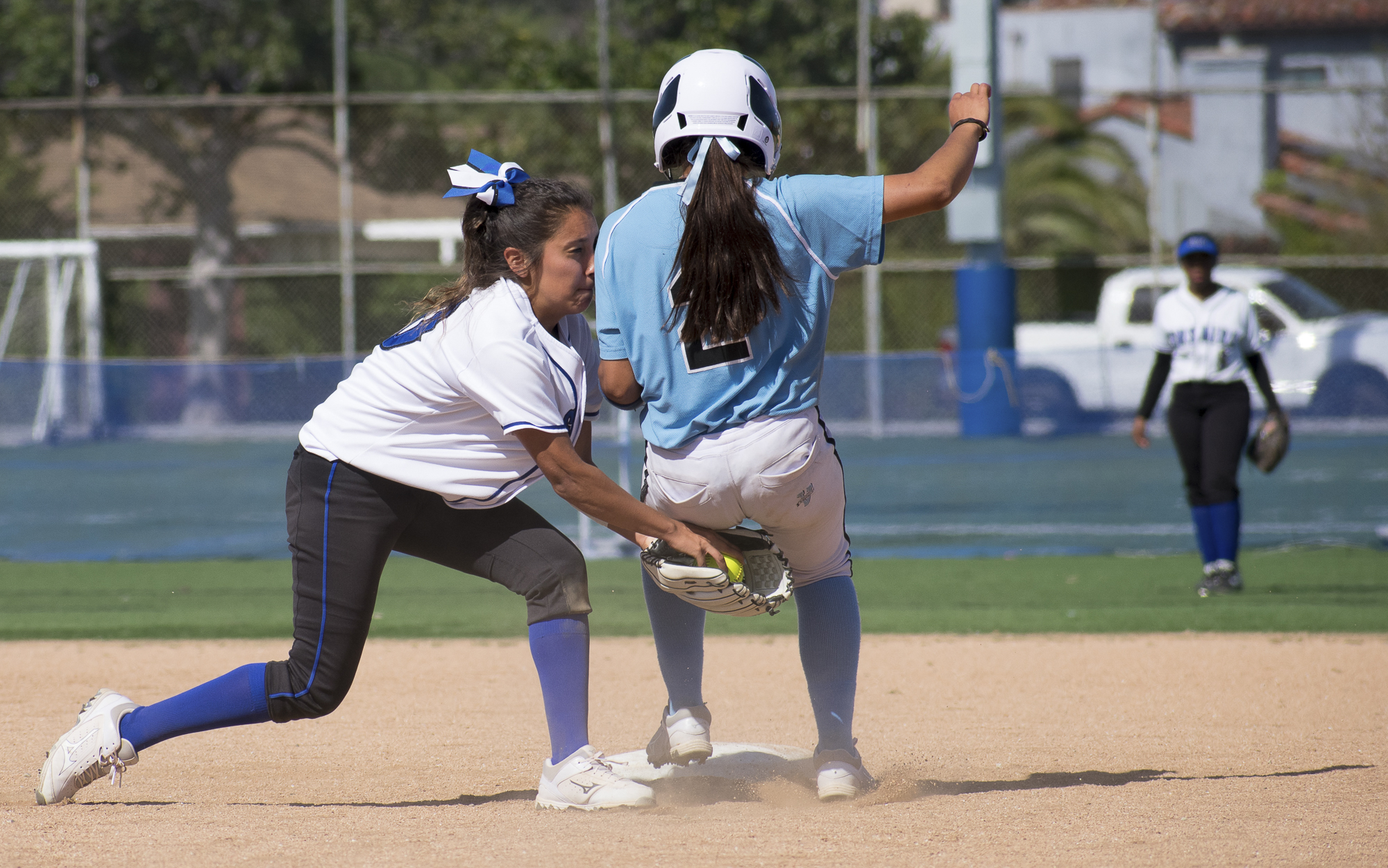 Santa Monica Corsairs Emma Soto (#80) defends the second base from Moorpark College Raiders Samantha Villa (#2) during a softball game on Tuesday, April 10 at the John Adams Middle School Field in Santa Monica, California. The game ended with an 11-8 loss for the Corsairs, further continuing their six-game loss. (Ethan Lauren/Corsair Photo)