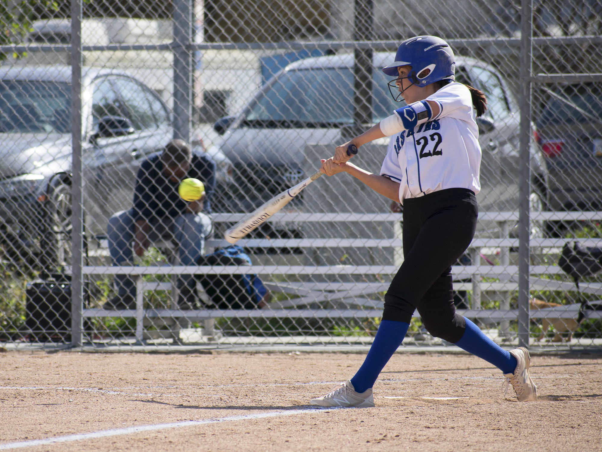Santa Monica Corsairs Erika Soto (#22) swings during a softball game against the Moorpark College Raiders on Tuesday, April 10 at the John Adams Middle School Field in Santa Monica, California. The game ended with an 11-8 loss for the Corsairs, further continuing their six-game loss. (Ethan Lauren/Corsair Photo)