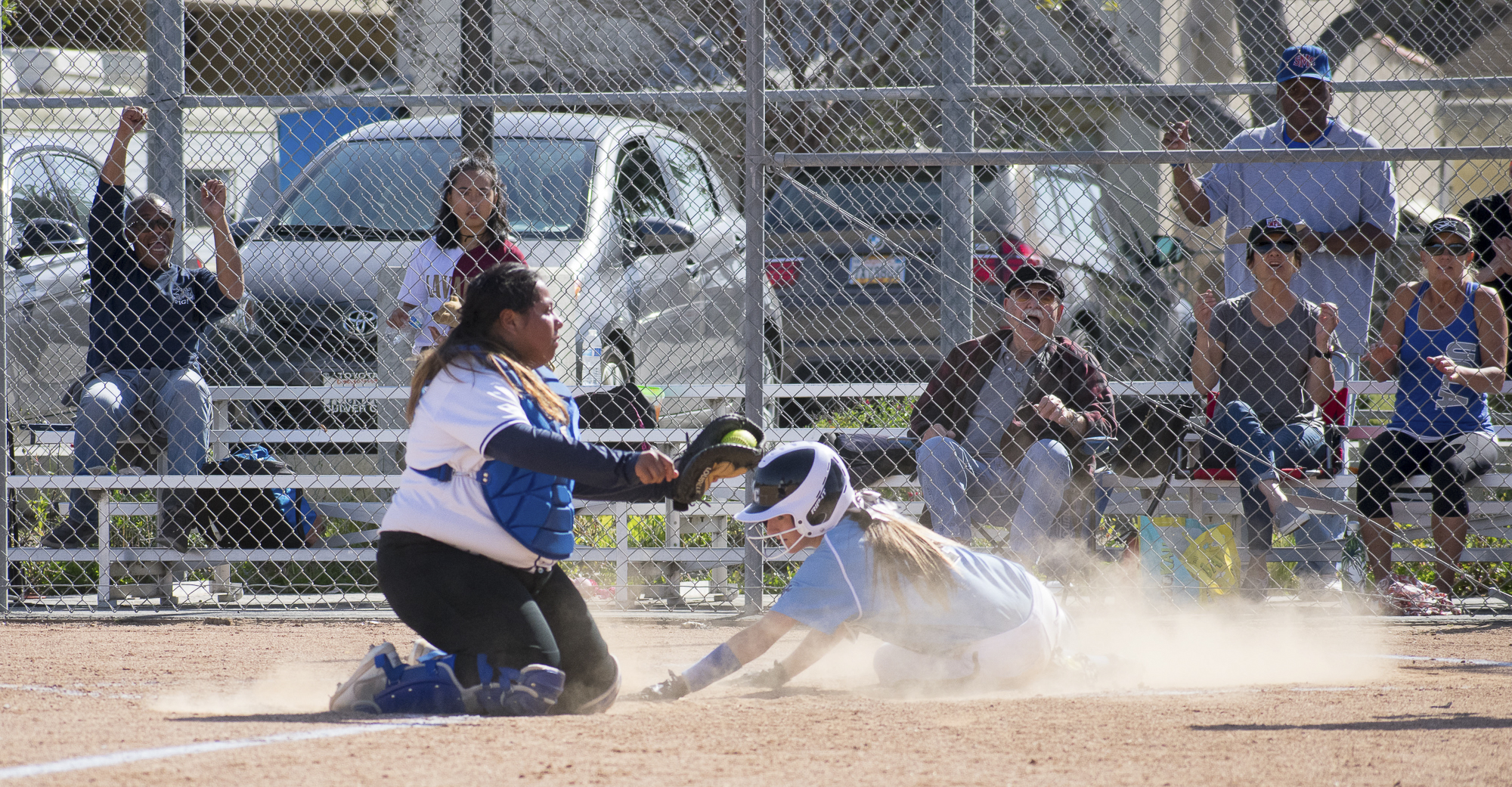 Moorpark College Raiders Lexi Brown (#4) fails to finish a run against the Santa Monica Corsairs during a softball game on Tuesday, April 10 at the John Adams Middle School Field in Santa Monica, California. The game ended with an 11-8 loss for the Corsairs, further continuing their six-game loss. (Ethan Lauren/Corsair Photo)