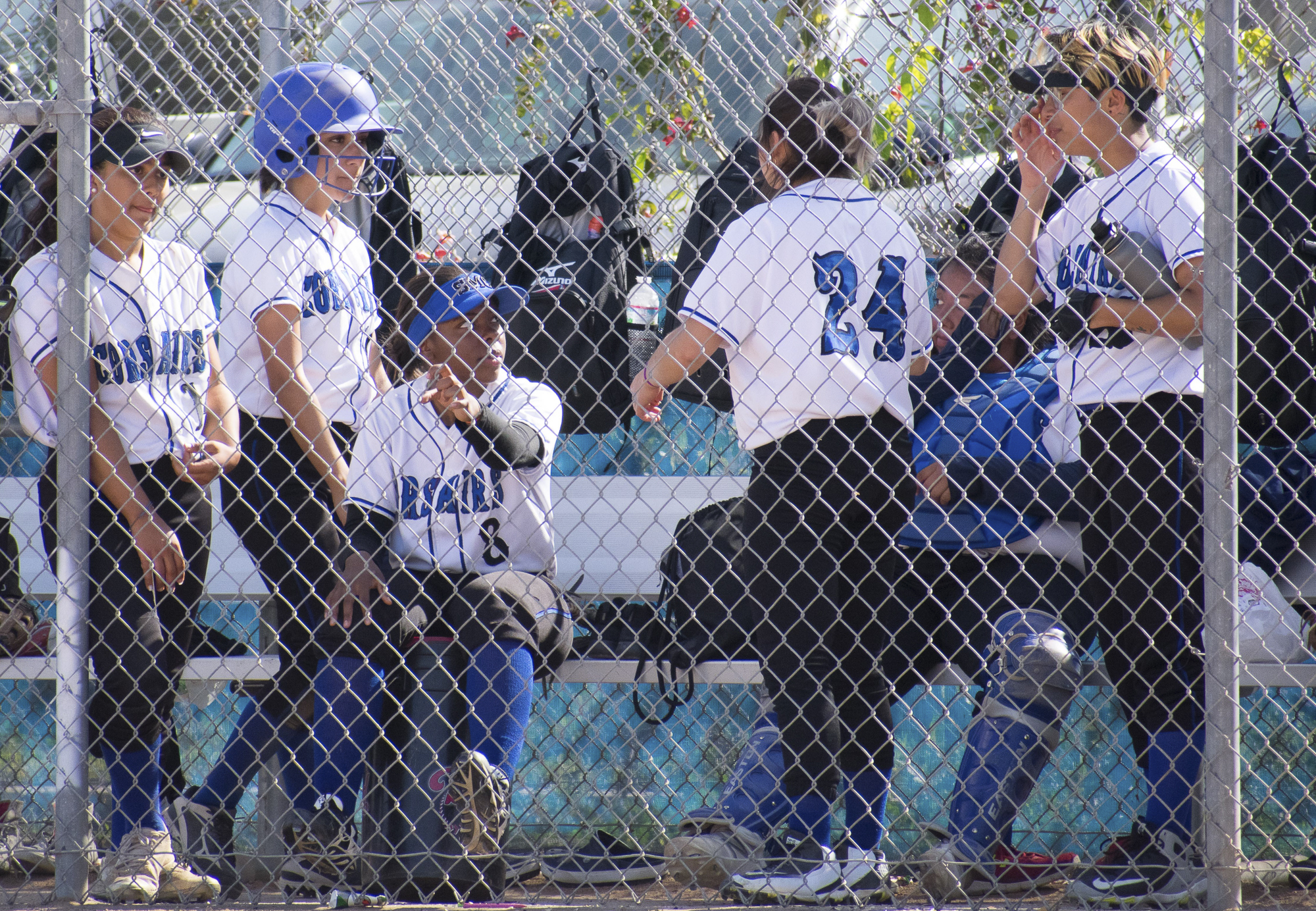 The Santa Monica Corsairs stop at the dugout during the sixth inning at a softball game on Tuesday, April 10 at the John Adams Middle School Field in Santa Monica, California. The game ended with an 11-8 loss for the Corsairs, further continuing their six-game loss. (Ethan Lauren/Corsair Photo)