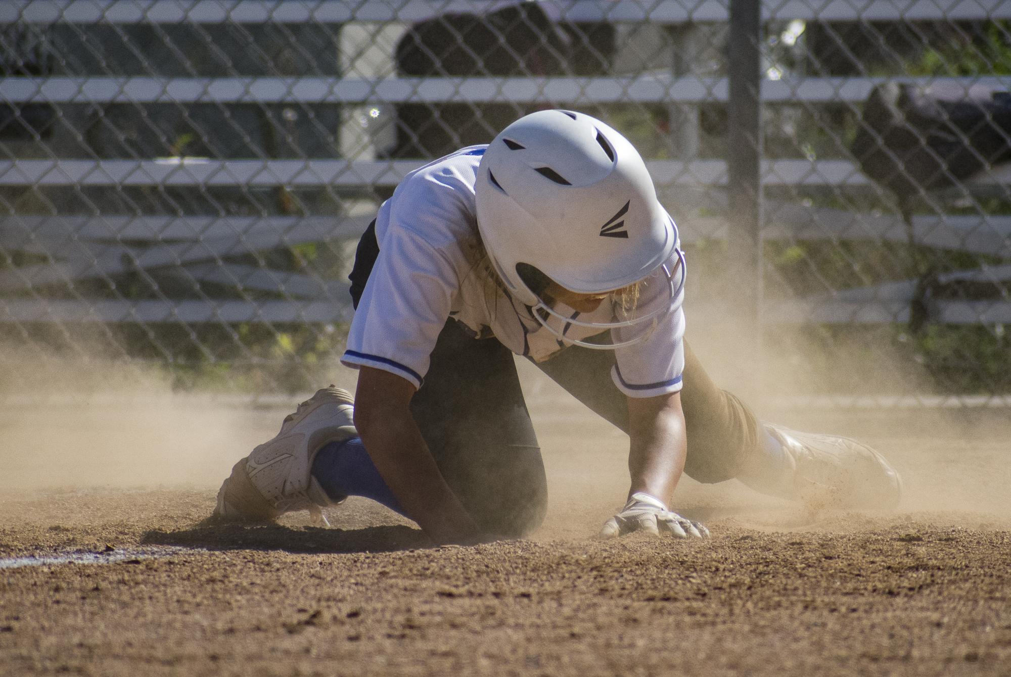 Santa Monica Corsairs Taylor Liebesman (#23) fails to finish a run despite sliding during a softball game against the Moorpark College Raiders on Tuesday, April 10 at the John Adams Middle School Field in Santa Monica, California. The game ended with an 11-8 loss for the Corsairs, further continuing their six-game loss. (Ethan Lauren/Corsair Photo)