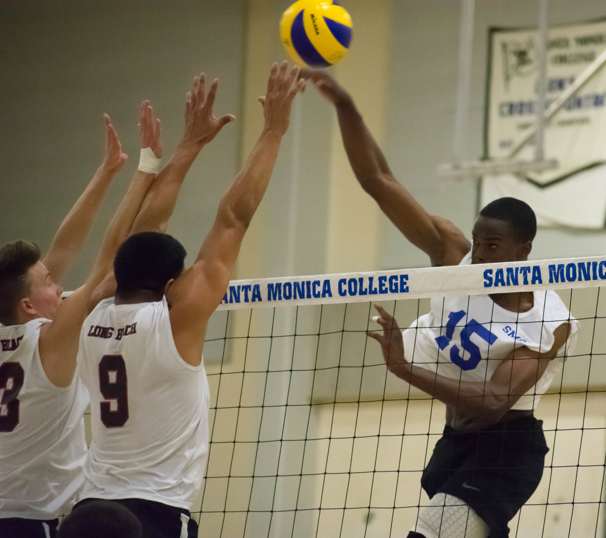 Santa Monica Corsairs sophomore and middle hitter Vecas Lewin (#15) prepares to spike the ball against the Long Beach City College Vikings during their final home game of the season on Wednesday, April 12, 2018 in the Santa Monica College gym at Santa Monica, California. The game ended in a 3-1 loss for the Corsairs, giving them a 7-7 overall rating for the season with one game left. (Ethan Lauren/Corsair Photo)