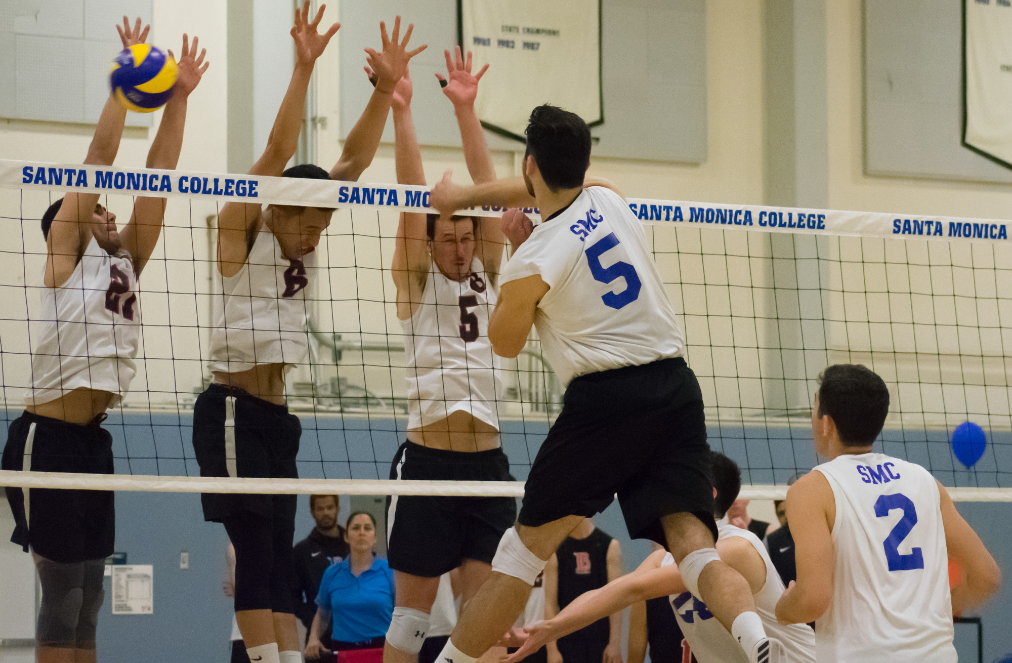 Santa Monica Corsairs sophomore and right-side hitter Andrew Dalmada (#5) spikes the ball against the Long Beach City College Vikings during their final home game of the season on Wednesday, April 12, 2018 in the Santa Monica College gym at Santa Monica, California. The game ended in a 3-1 loss for the Corsairs, giving them a 7-7 overall rating for the season with one game left. (Ethan Lauren/Corsair Photo)