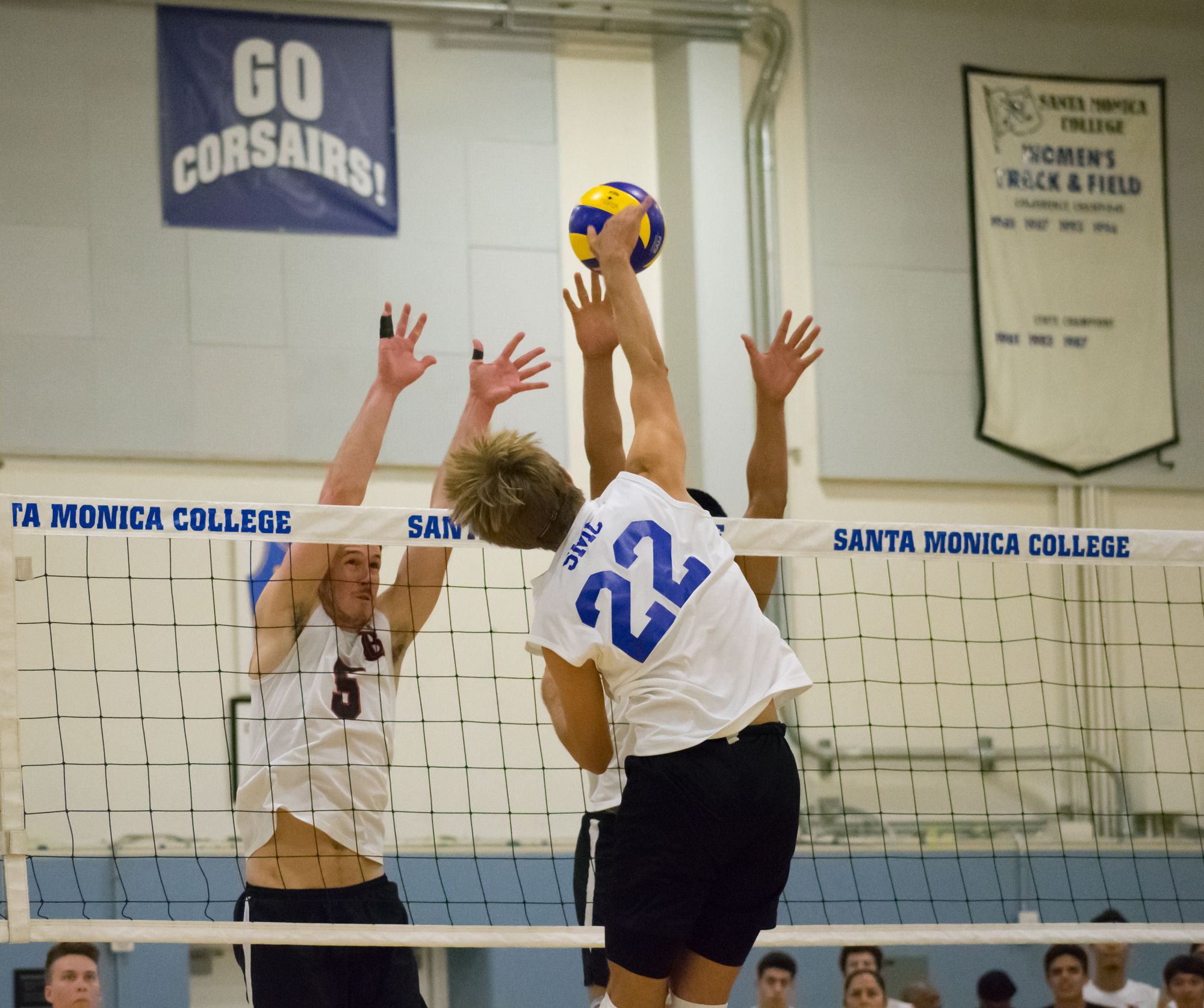 Santa Monica Corsairs sophomore and outside hitter Stanton Smith (#22) spikes the ball against the Long Beach City College Vikings during their final home game of the season on Wednesday, April 12, 2018 in the Santa Monica College gym at Santa Monica, California. The game ended in a 3-1 loss for the Corsairs, giving them a 7-7 overall rating for the season with one game left. (Ethan Lauren/Corsair Photo)
