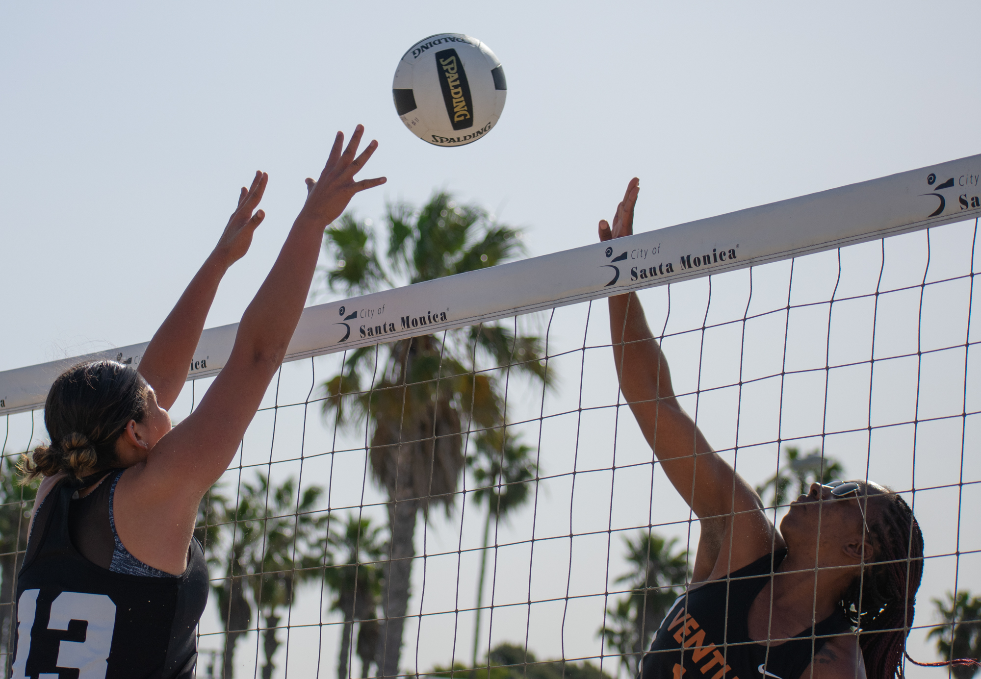 Santa Monica College Corsair Ada Nadzakova (#13) prepares to defend against Armonee Hunter (#10) of the Ventura College Pirates during a conference game of beach volleyball in court two at the Santa Monica beach on Friday, April 13, 2018 in Santa Monica, California. It was a 4-1 loss for the Corsairs, bringing their total to 2-11 for the season. (Ethan Lauren/Corsair Photo)