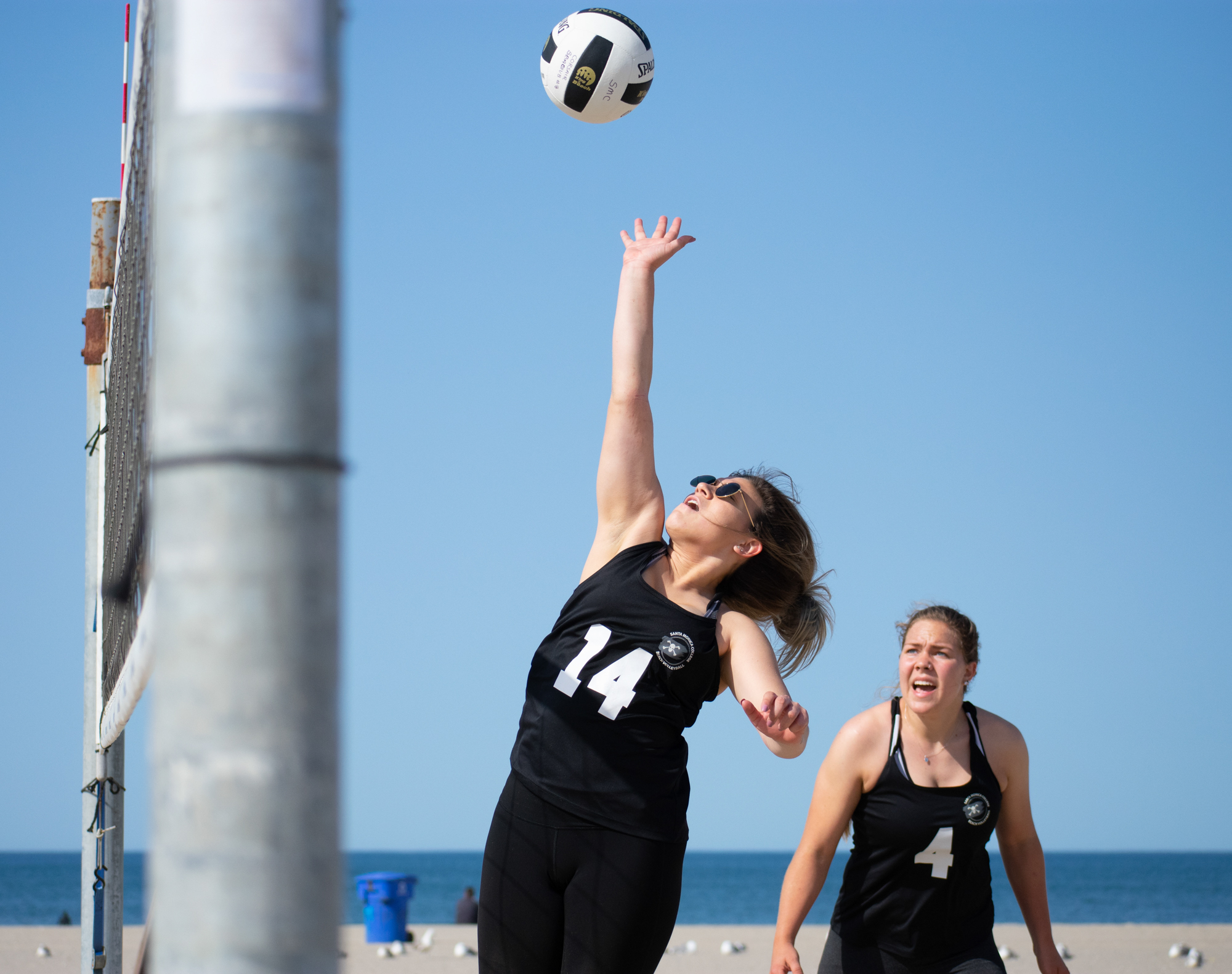 Santa Monica College Corsair Kelsi Pich (#14) attempts to defend the ball as partner Camryne Sommaripa (#4) looks on during a conference game of beach volleyball in court four against the Ventura College Pirates at the Santa Monica beach on Friday, April 13, 2018 in Santa Monica, California. It was a 4-1 loss for the Corsairs, bringing their total to 2-11 for the season. (Ethan Lauren/Corsair Photo)