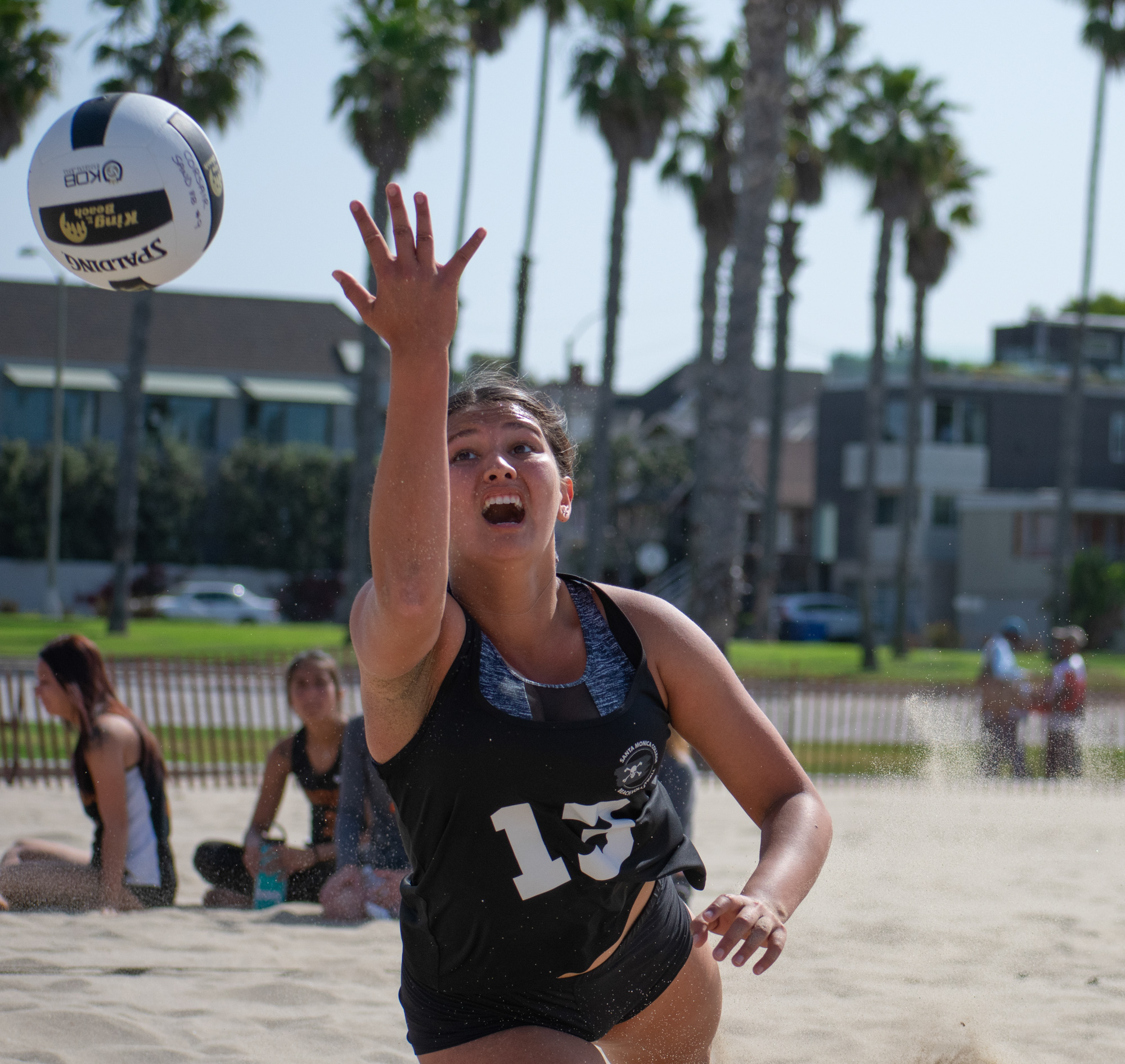 Santa Monica College Corsair Ada Nadzakova (#13) misses the ball against the Ventura College Pirates, Kasie Spencer (#13) and Armonee Hunter (#10) during a conference game of beach volleyball at the Santa Monica beach on Friday, April 13, 2018 in Santa Monica, California. It was a 4-1 loss for the Corsairs, bringing their total to 2-11 for the season. (Ethan Lauren/Corsair Photo)