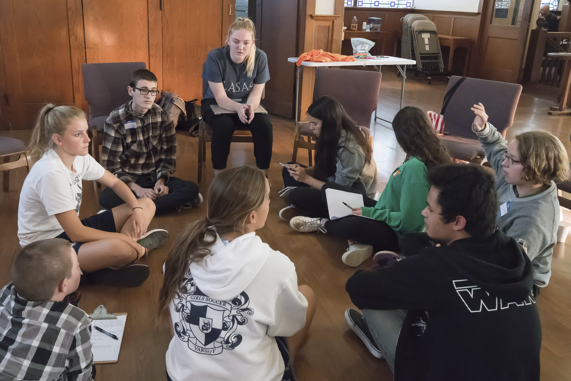 Students from several Los Angeles area high schools met in Santa Monica, California on Tuesday, April 17, 2018 to discuss a planned walkout and protest rally at Santa Monica City Hall on Friday, April 20. Clockwise from top center: Camille Hannant, Maddie Fenster, Aislinn Russell, Spencer Newman, Lorenzo De Los Reyes, Lea Yamashiro, Roger Gawne, Siri Storstein, and Travis Ackermann.  (Helena Sung/Corsair Staff)