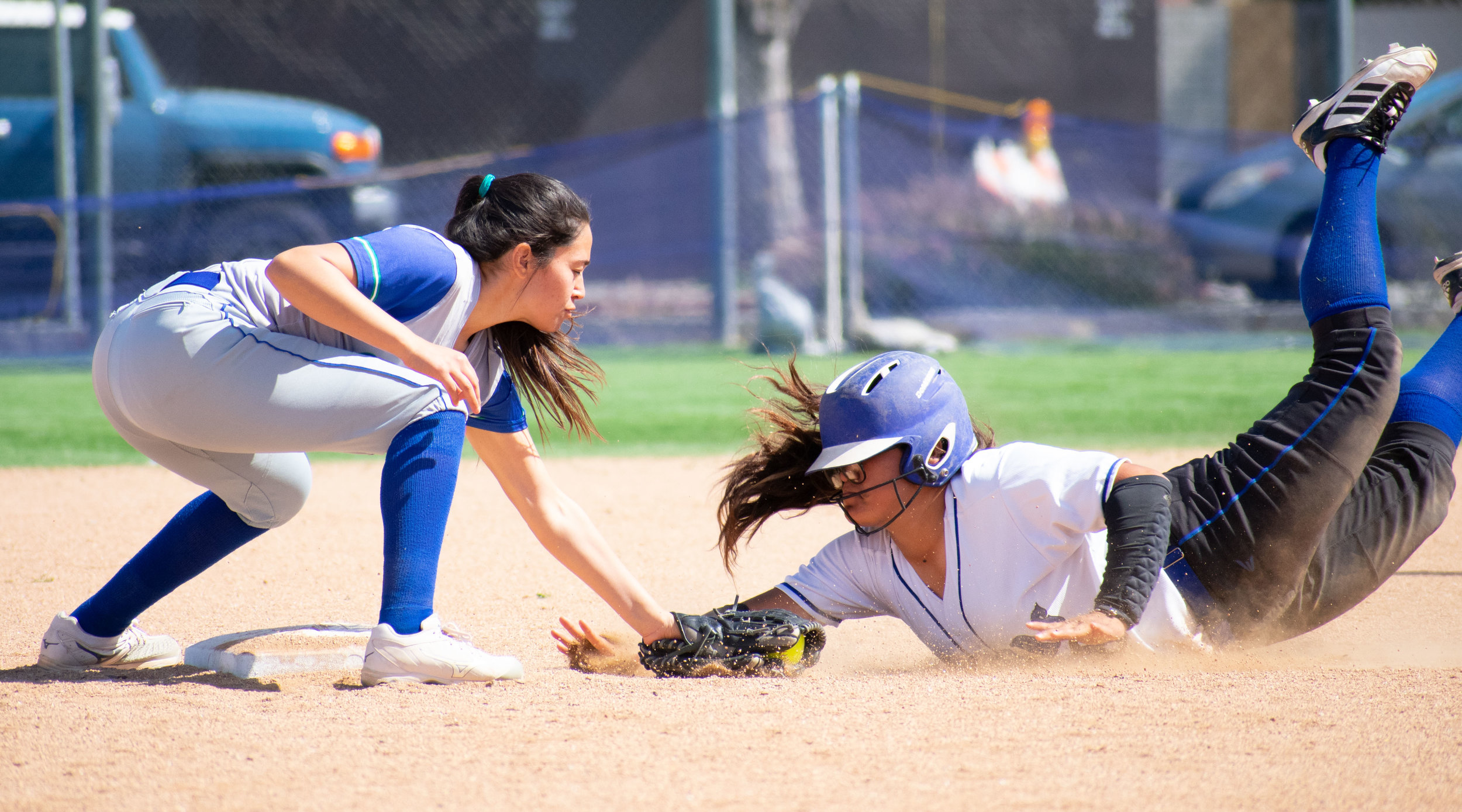 Santa Monica College Corsair Vania Garcia (#18) futilely slides into second base as Oxnard Condor Airin Lara (#1) taps her out in a softball game on Thursday, April 19, 2018 at the John Adams Middle School Field in Santa Monica, California. The game ended with an 3-2 win for the Corsairs, breaking a seven-game losing streak on their penultimate game of the season. (Ethan Lauren/Corsair Photo)