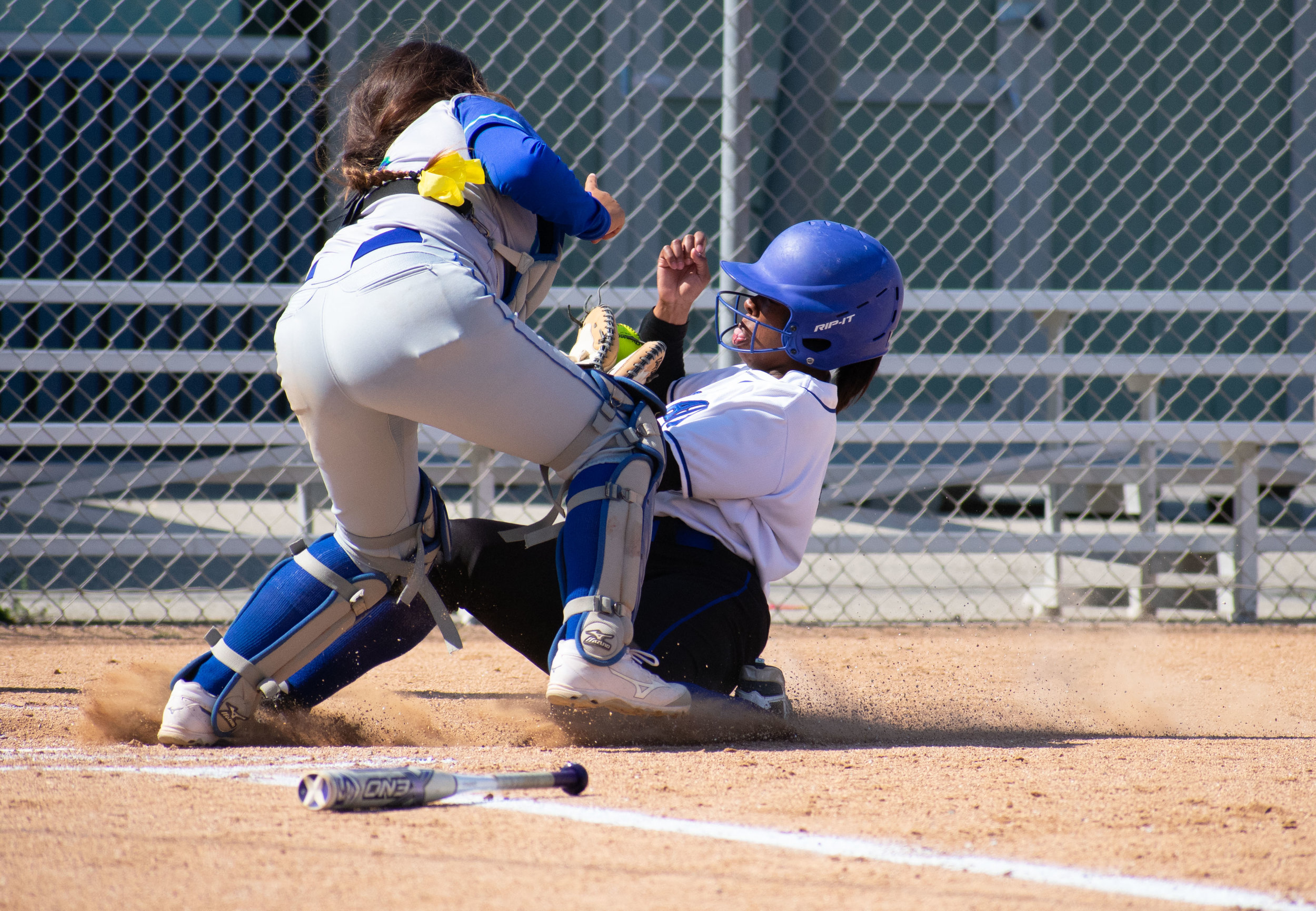 Santa Monica College Corsair Kahlaysia Miller (#8) fails to make it home in a softball game against the Oxnard Condors on Thursday, April 19, 2018 at the John Adams Middle School Field in Santa Monica, California. The game ended with an 3-2 win for the Corsairs, breaking a seven-game losing streak on their penultimate game of the season. (Ethan Lauren/Corsair Photo)