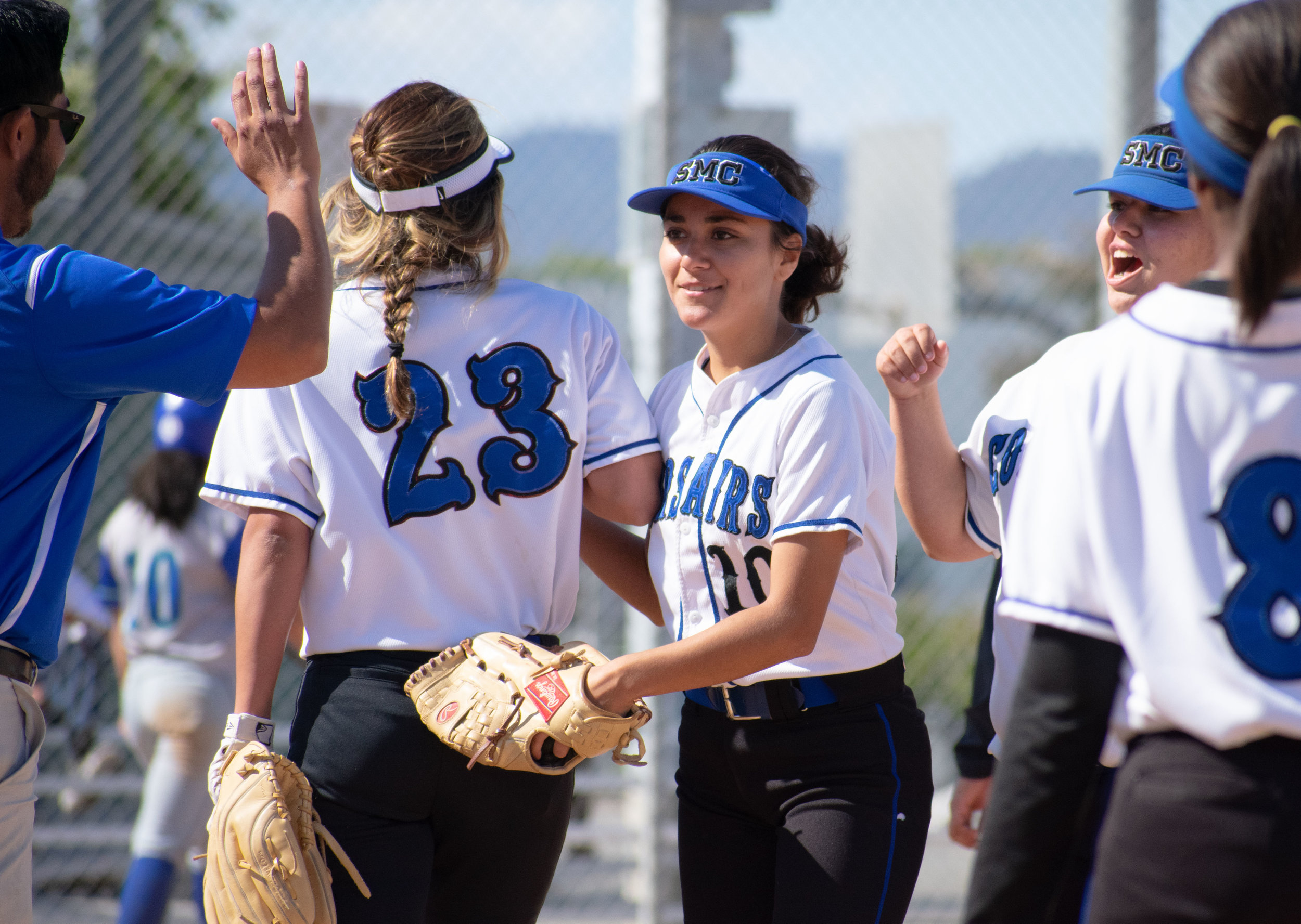 Santa Monica College Corsair Briana Osuna (#10), center, congratulates with the rest of the team after a 3-2 win against the Oxnard Condors in a softball game on Thursday, April 19, 2018 at the John Adams Middle School Field in Santa Monica, California. The game broke a seven-game losing streak on their penultimate game of the season. (Ethan Lauren/Corsair Photo)