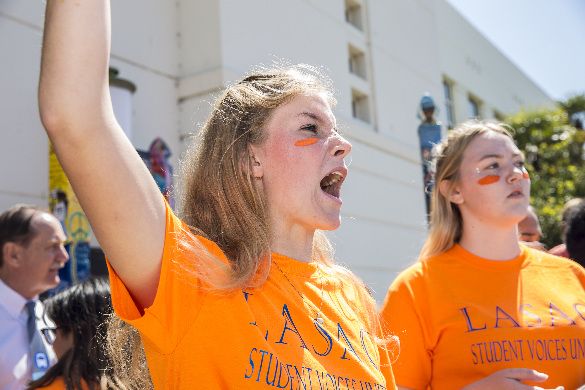 Santa Monica High students Siri Storstein (left) and Camille Hannant (right) start chanting during the student walkout that converged at Santa Monica City Hall in Santa Monica California, on Friday, April 20 2018. Several hundred students from area high schools and middle schools converged on Santa Monica City Hall in protest against all forms of gun violence, marking also the 19th anniversary of the Columbine High School massacre. (Matthew Martin/Corsair Photo)