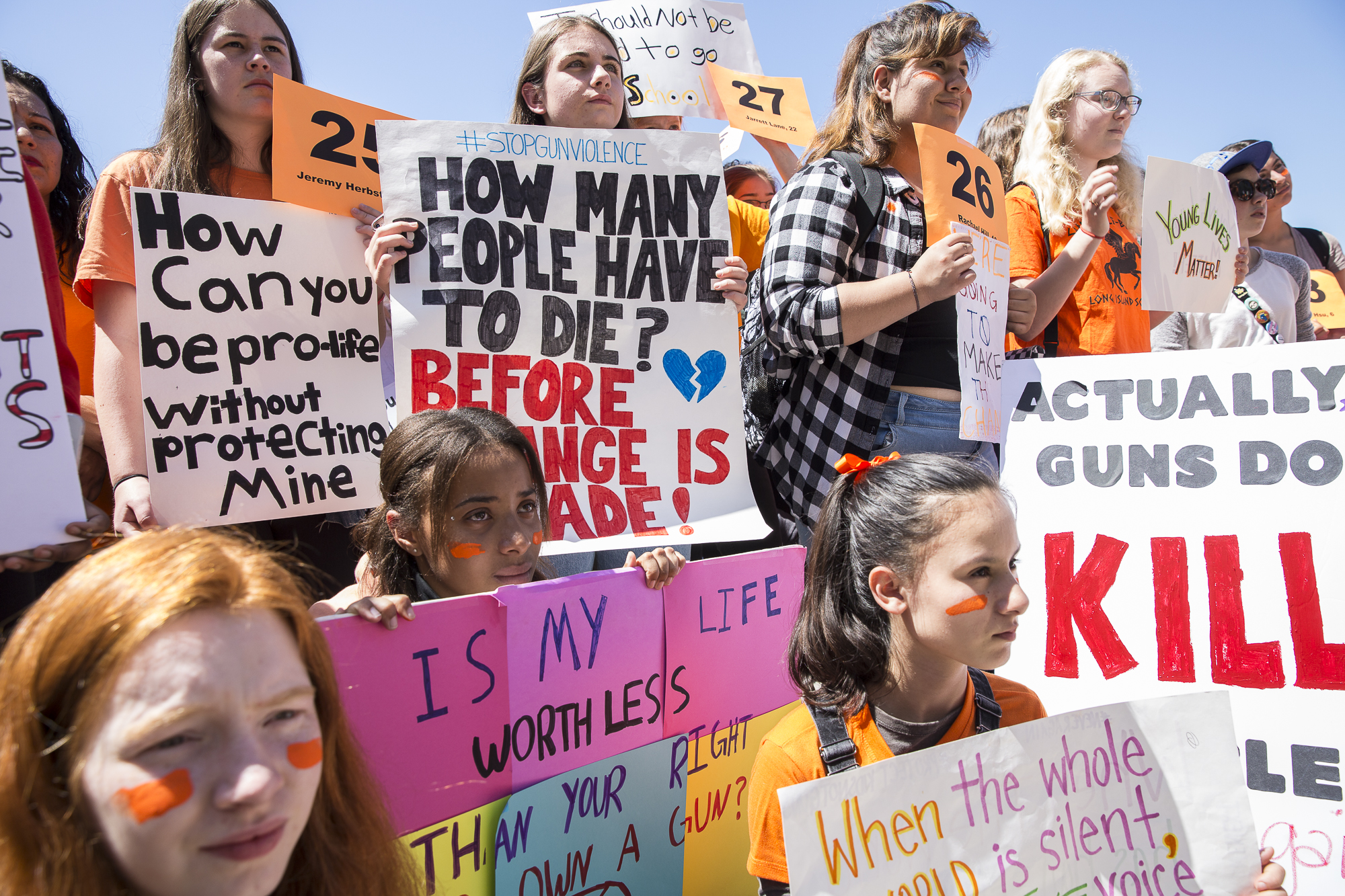 Young student activists from neighboring Santa Monica Middle Schools and High Schools hold up signs that express a desire for gun regulation while listening to key speakers during a student walkout that converged at Santa Monica City Hall in Santa Monica, California on Friday, April 20 2018. The student walkout marked the 19th anniversary of the Columbine High School massacre shooting and walkouts took place across the country so students could express their desire for a change in gun legislation. (Matthew Martin/Corsair Photo)