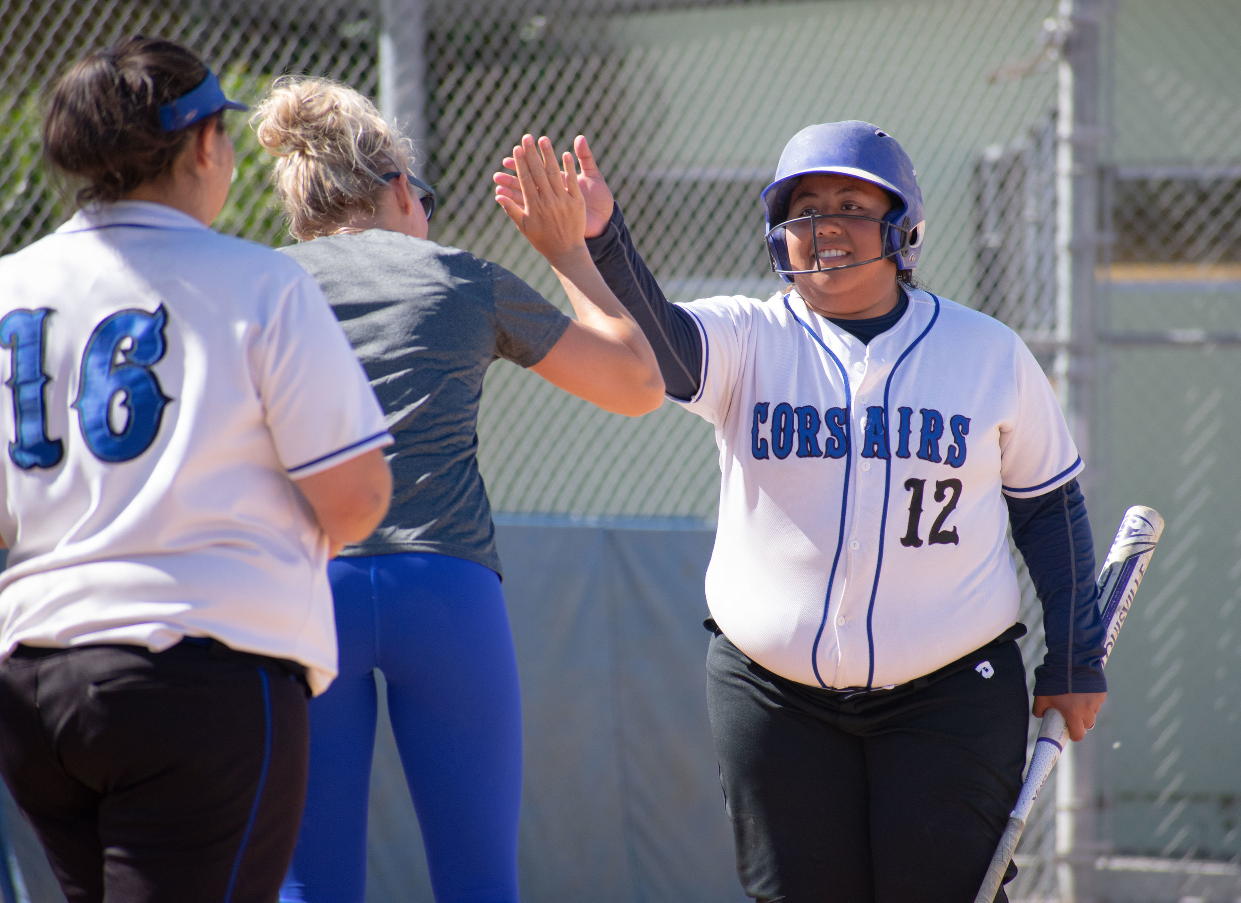 Santa Monica College Corsair Ashley Sasso (#12), a sophomore playing her last game sees assistant coach Sam Sheeley during the final game of the season against the Santa Barbara Vaqueros on Friday, April 20, 2018 at the John Adams Middle School Field in Santa Monica, California. The game was a 7-1 loss for the Corsairs, ending the season with an 8-21 record. (Ethan Lauren/Corsair Photo)
