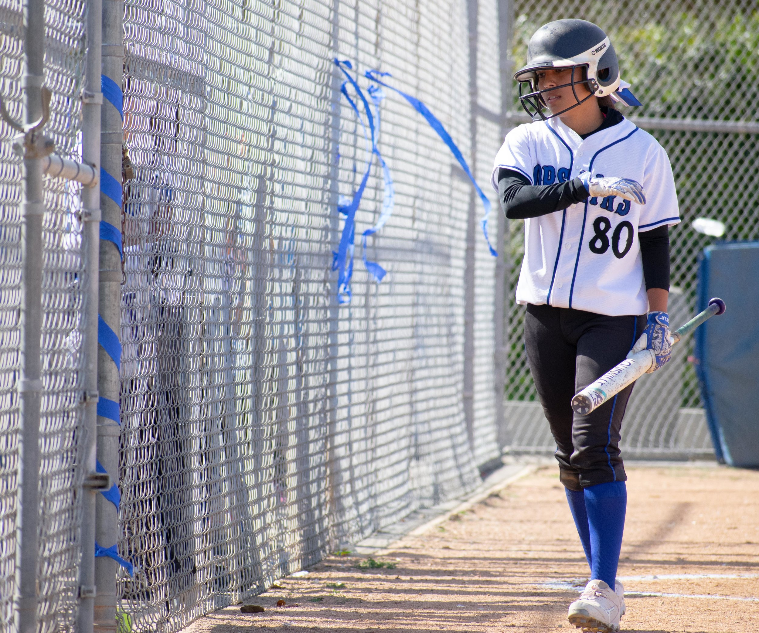 Santa Monica College Corsair Emma Soto (#80) walks to the dugout during the final game of the season against the Santa Barbara Vaqueros on Friday, April 20, 2018 at the John Adams Middle School Field in Santa Monica, California. The game was a 7-1 loss for the Corsairs, ending the season with an 8-21 record. (Ethan Lauren/Corsair Photo)