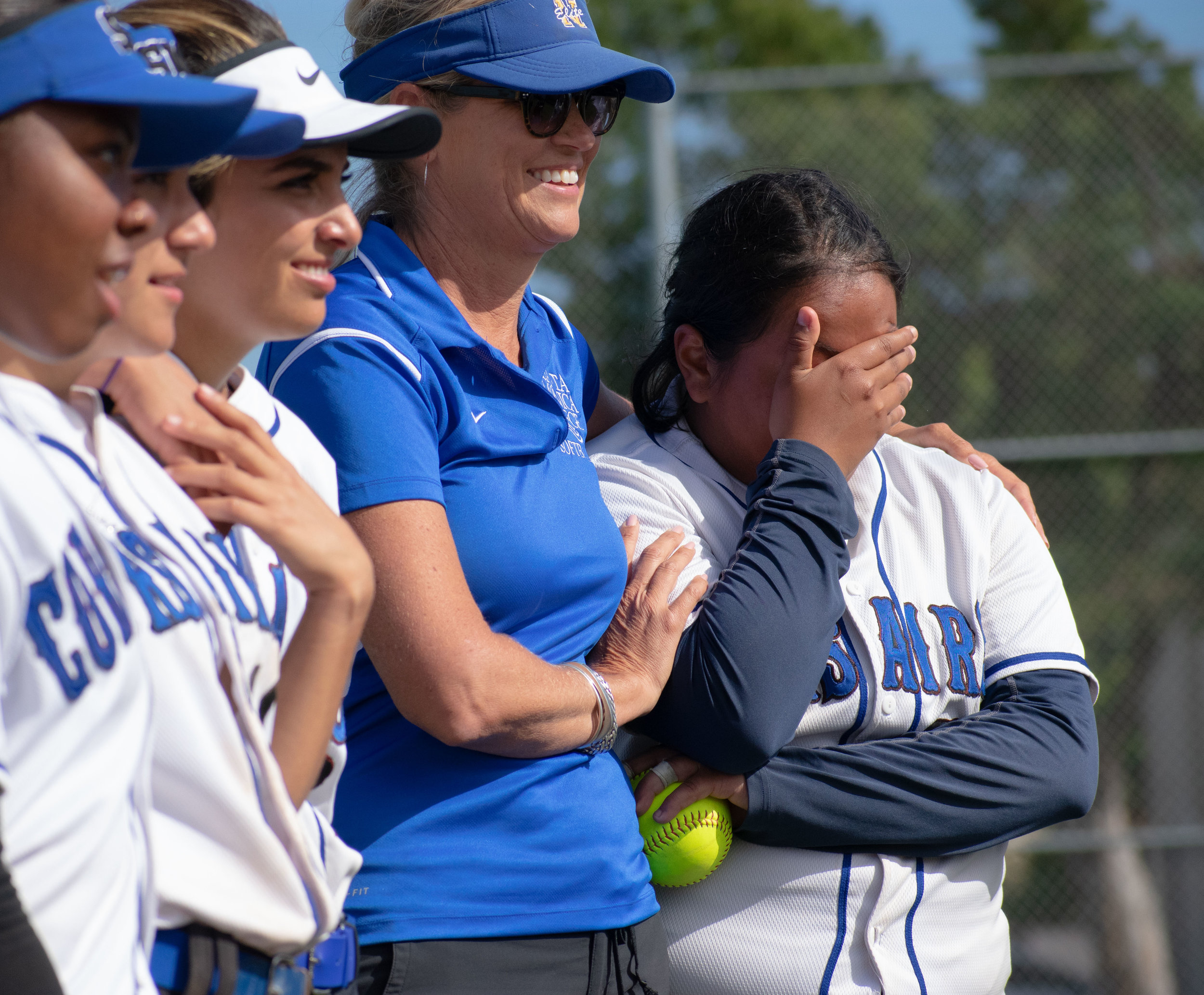 Santa Monica College Corsair Ashley Sasso (#12), right, a sophomore who played her last game gets emotional as the team discusses the season after the final game of the season against the Santa Barbara Vaqueros on Friday, April 20, 2018 at the John Adams Middle School Field in Santa Monica, California. The game was a 7-1 loss for the Corsairs, ending the season with an 8-21 record. (Ethan Lauren/Corsair Photo)