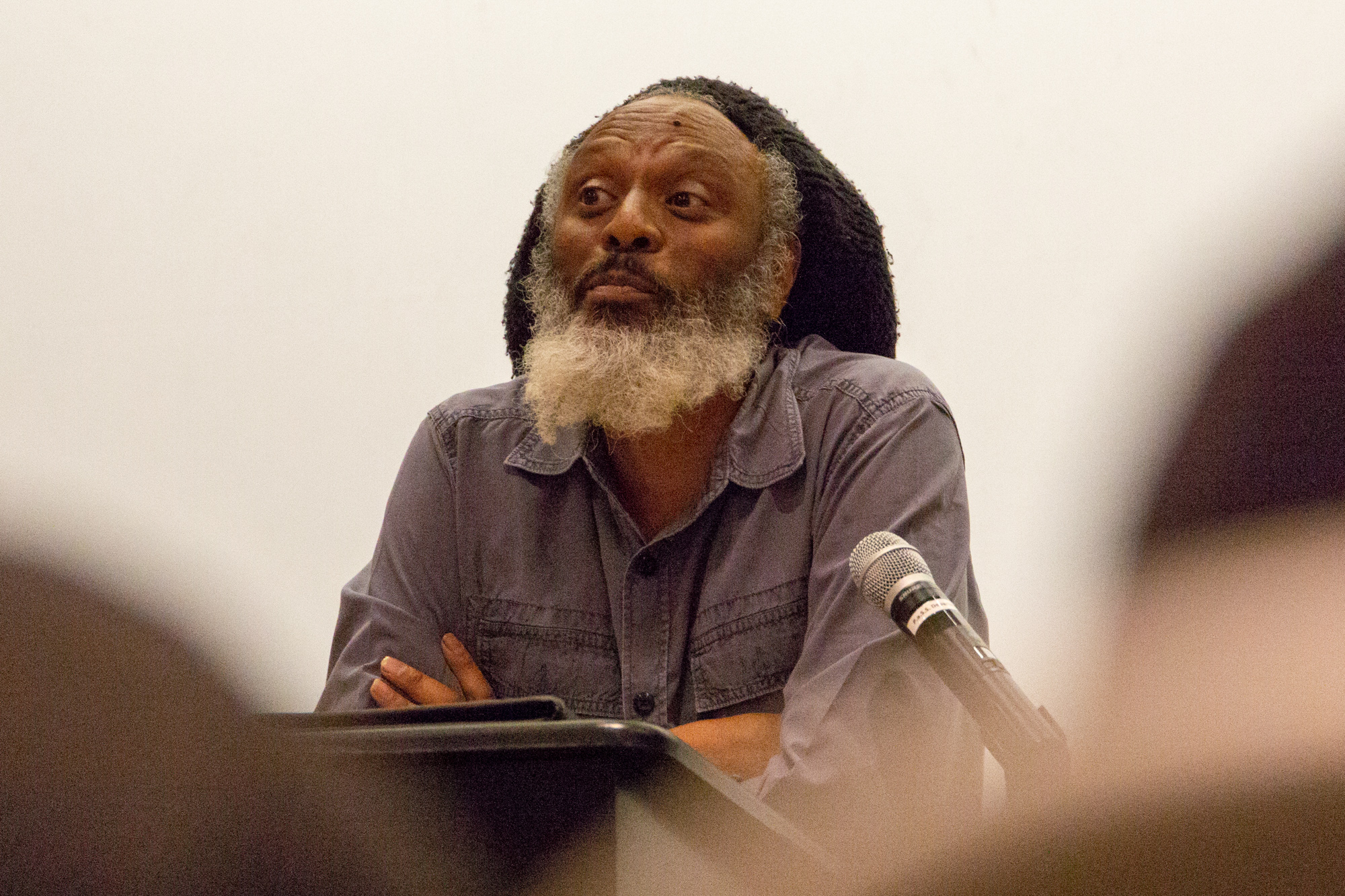 """Poet and Professor of English Wilfred Doucet reads from his work at the """"Modern Poetic Permutations"""" event held at Santa Monica College, Santa Monica, California on Thursday April 19 2018. on Thursday April 19 2018. (Ruth Iorio/ Corsair Photo)"""