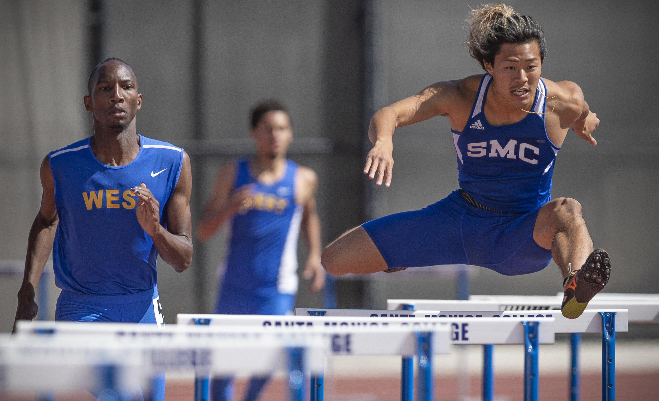 Santa Monica College 400 meter hurdle track and field athlete Gentore Sasaki (right) placed second in heat 2 of 3 during SMC's   preliminaries at Santa Monica College, on friday, April 20th, 2018, in Santa Monica, Calif.. (Photo By: Daniel Bowyer / Corsair Contributor)