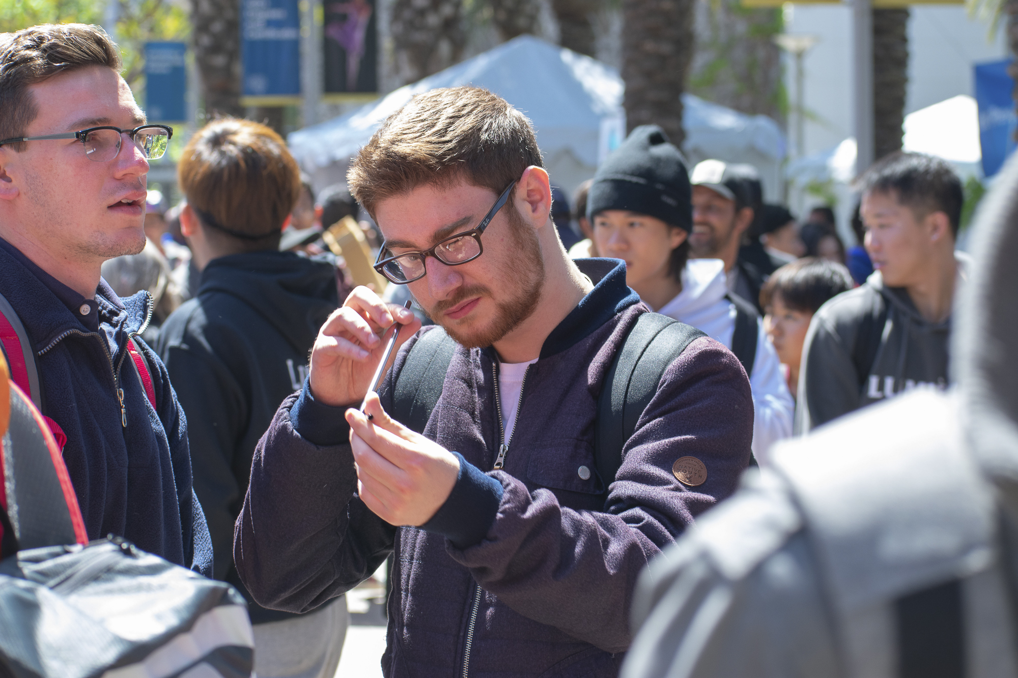 On the quad at Santa Monica College, Rafael Alvarez inspects a metal straw given to him by Plastic Free SMC during Club Row on Thursday, April 26, 2018 in Santa Monica, California. With over 60 clubs in attendance, the day is meant to encourage clubs to showcase what they've been doing over the semester for students. (Ethan Lauren/Corsair Photo)